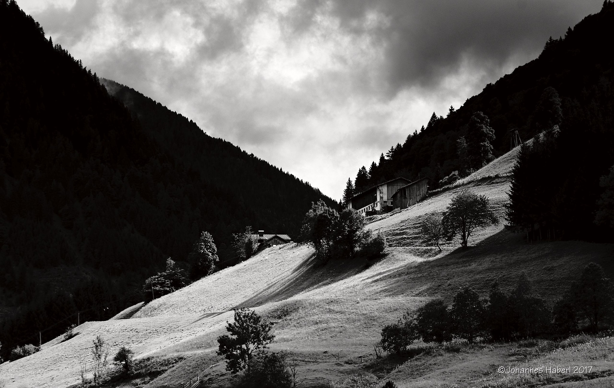 "some rays of light - at the beginning of the mountain road ""Grossglockner Hochalpenstrasse"" / B&W by Johannes Haberl"
