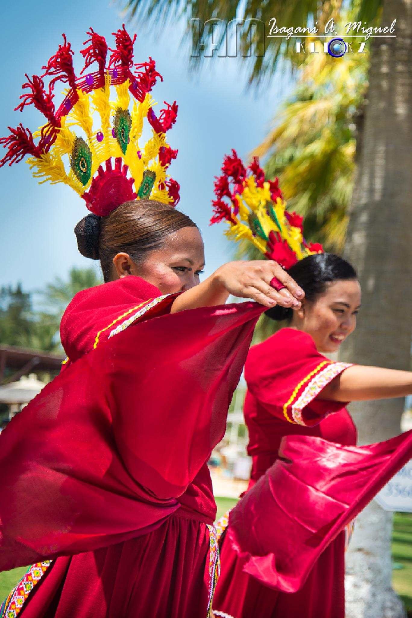 Cultural Dancers in Red by Isagani Miguel
