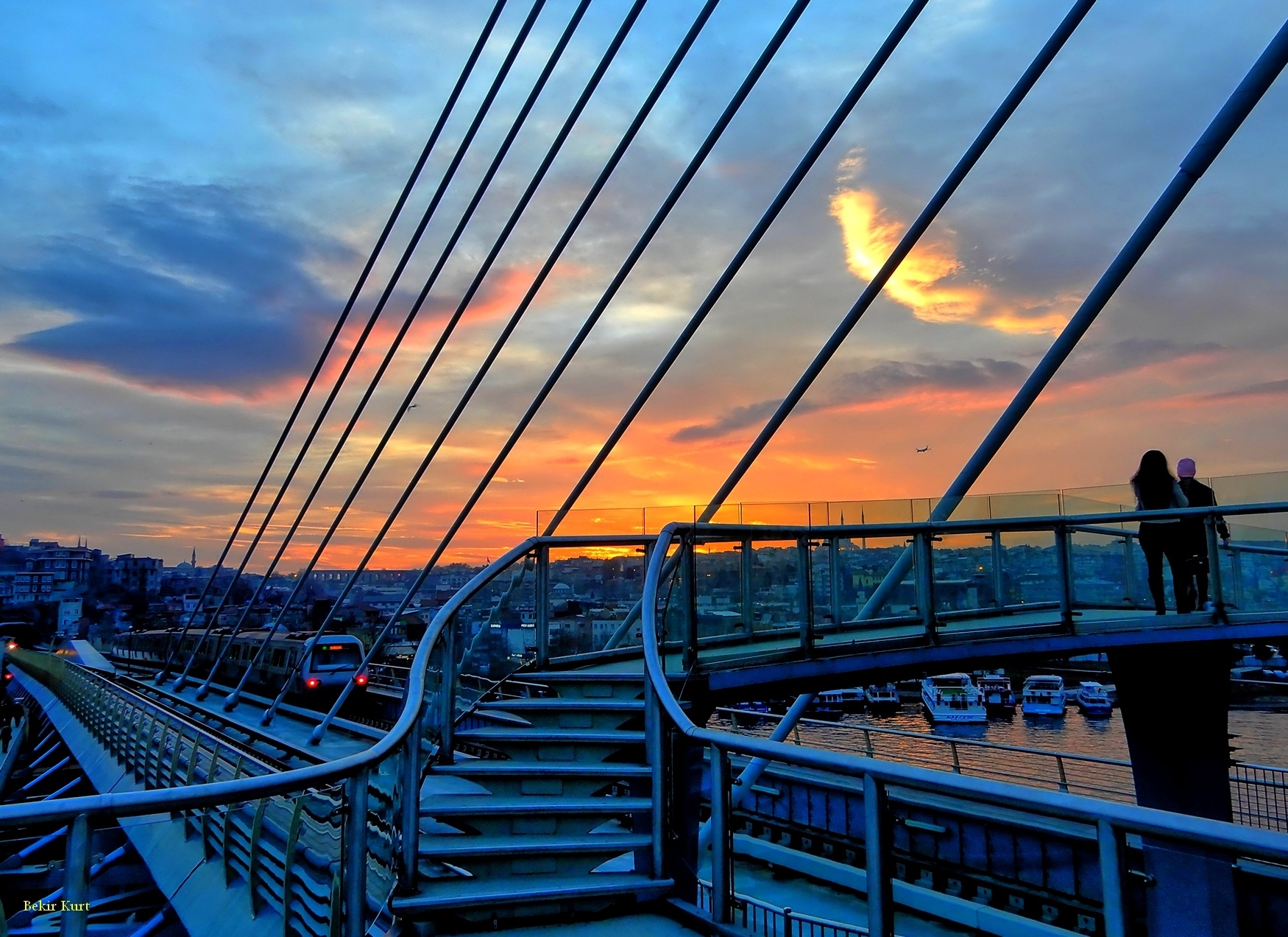 Sunset Over The Golden Horn Metro Bridge by Bekir Kurt