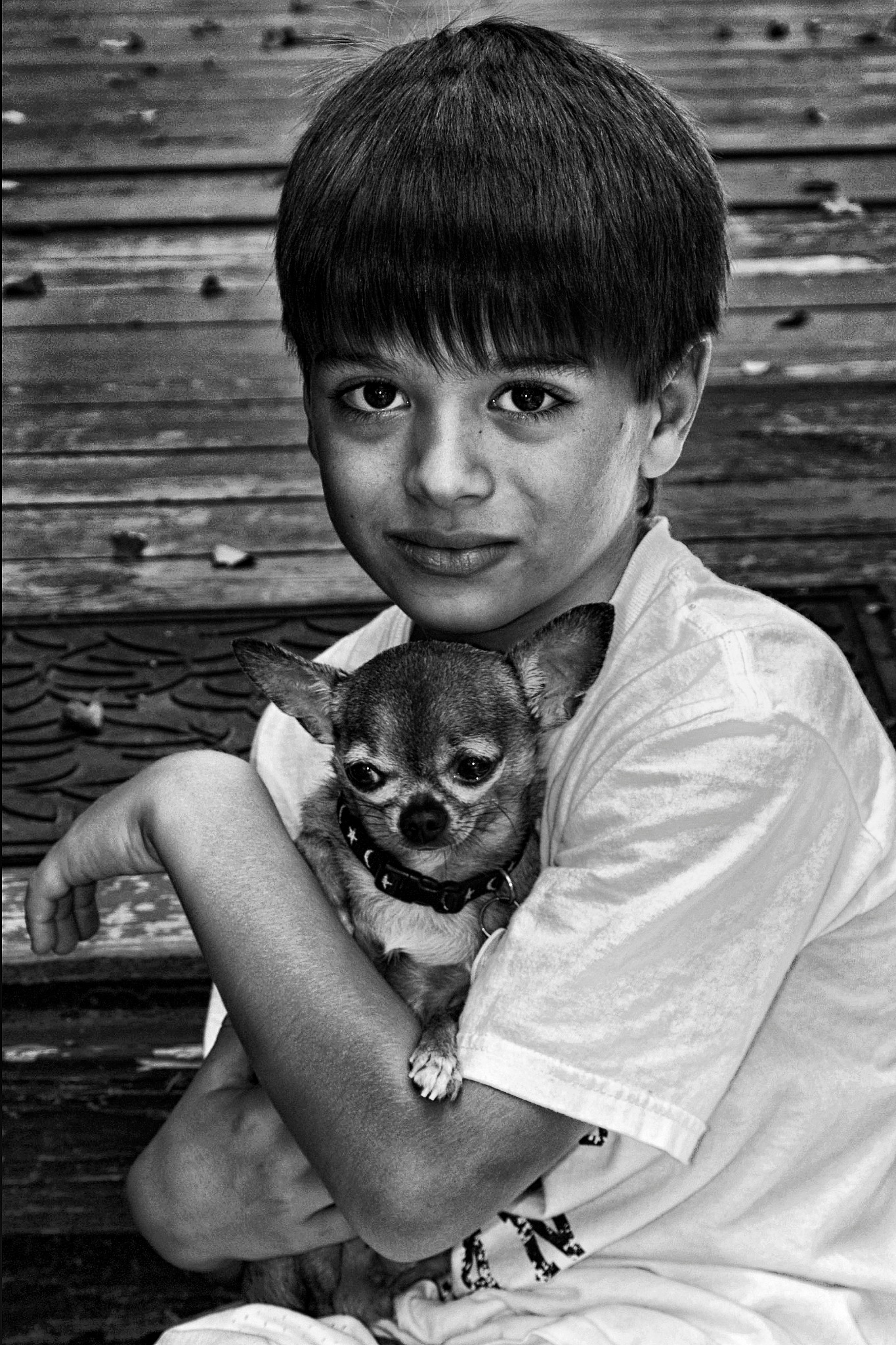 A boy and his dog by Joe Saladino