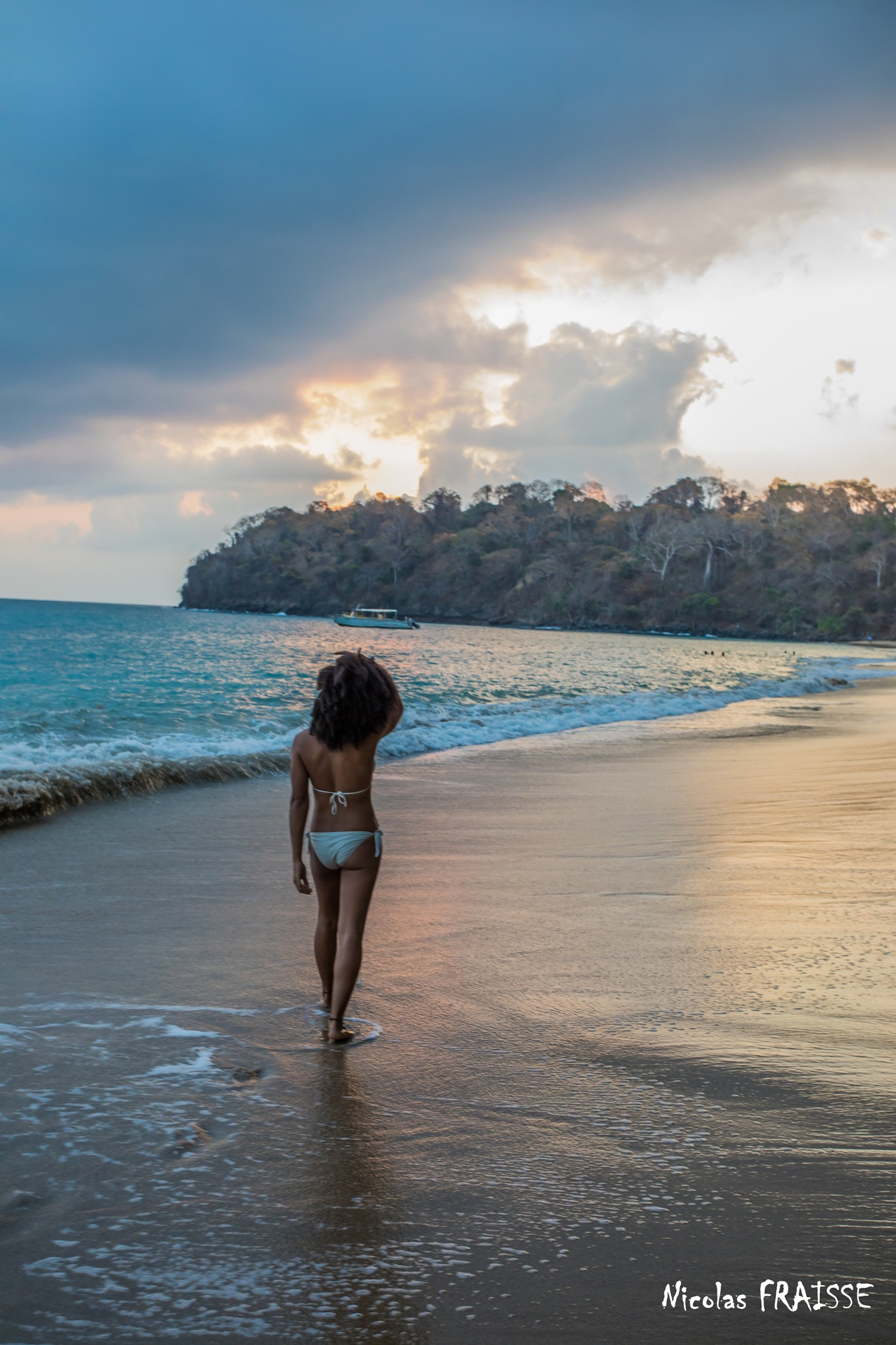 A charming girl at the beach by Nicolas F.