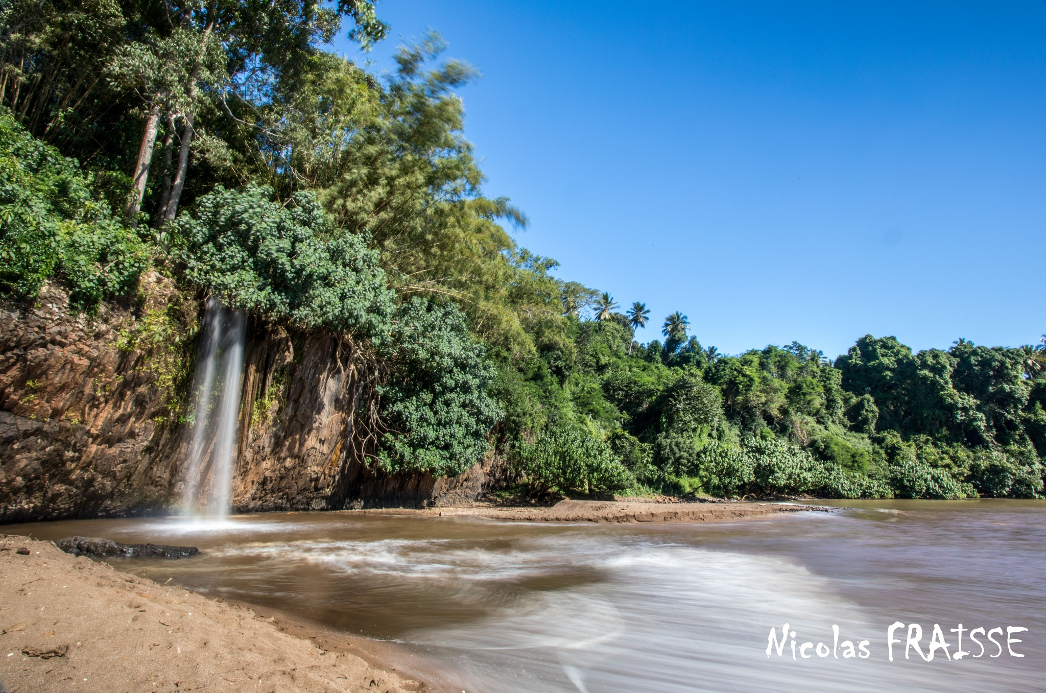 water falls on the beach by Nicolas F.