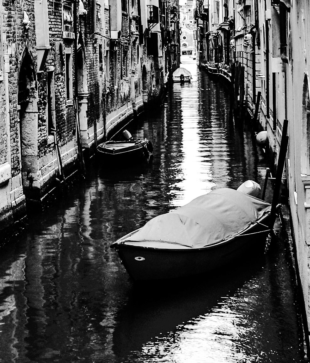 Venice canal with boats by simie