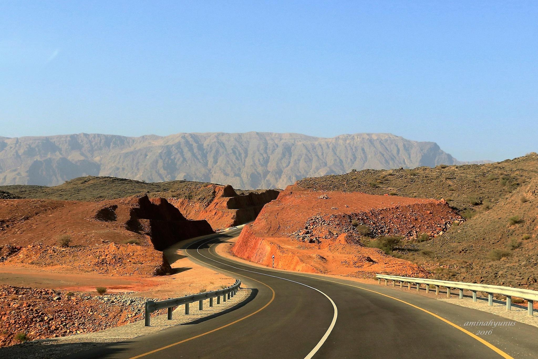 road into the mountain by Aminah Yunus