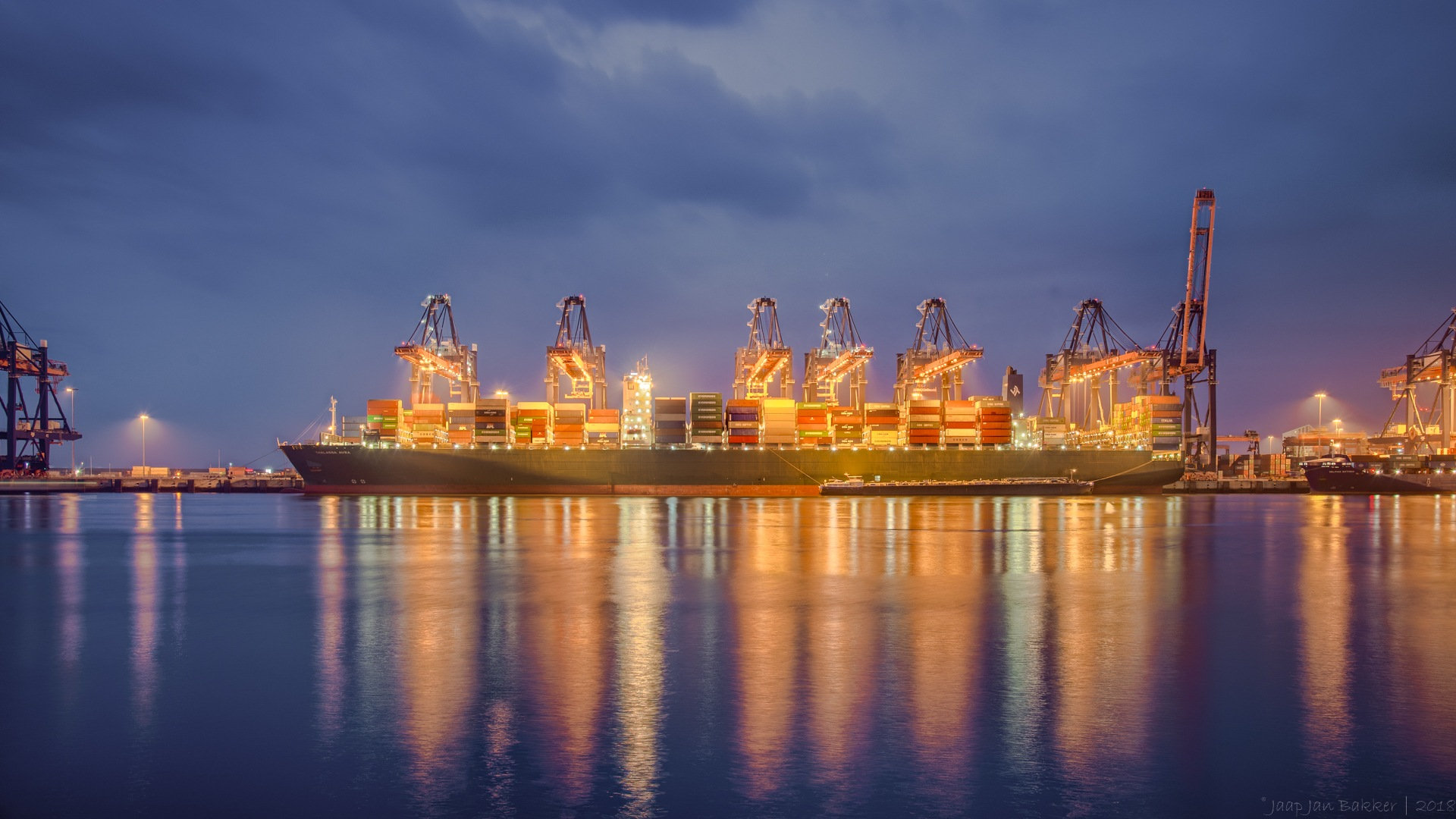 Ship  at container terminal. by Jaap Jan Bakker
