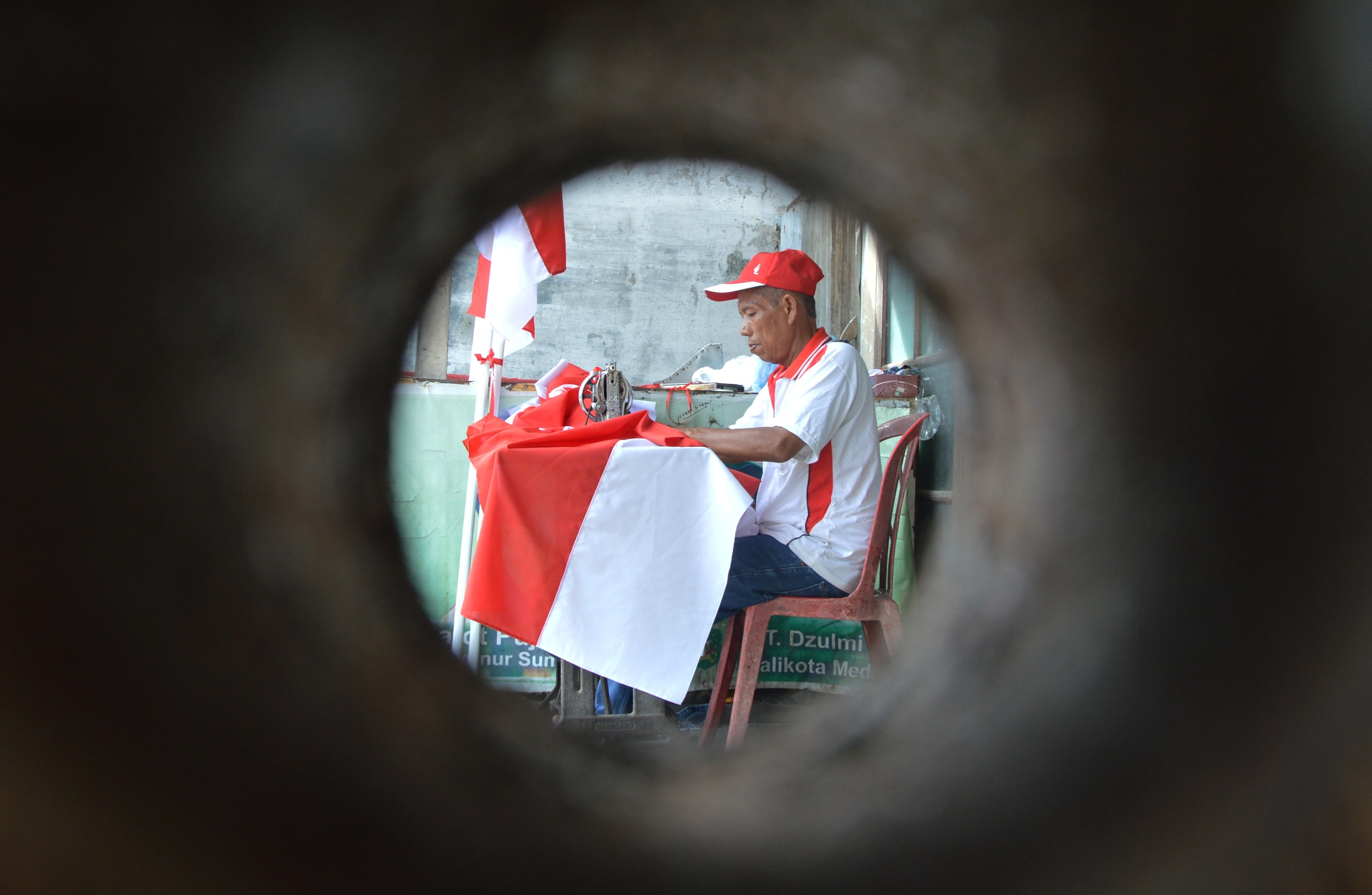 Tailors Red and White Flag Indonesia in Frame. by Rahmat Ramadhan Ritonga