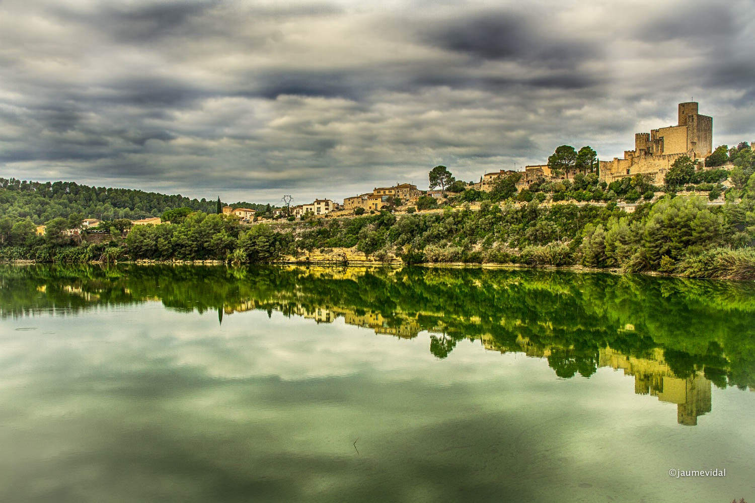 Reflections of the village of Castellet in the marsh of Foix by JaumeVidal