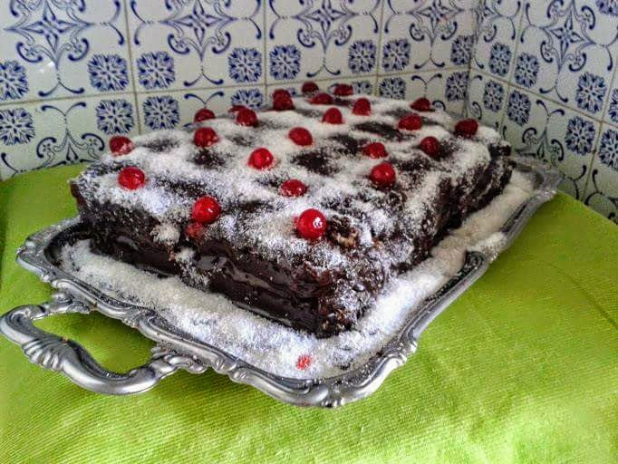 Chocolate cake topped with coconut and decorated with cherries by Sonja