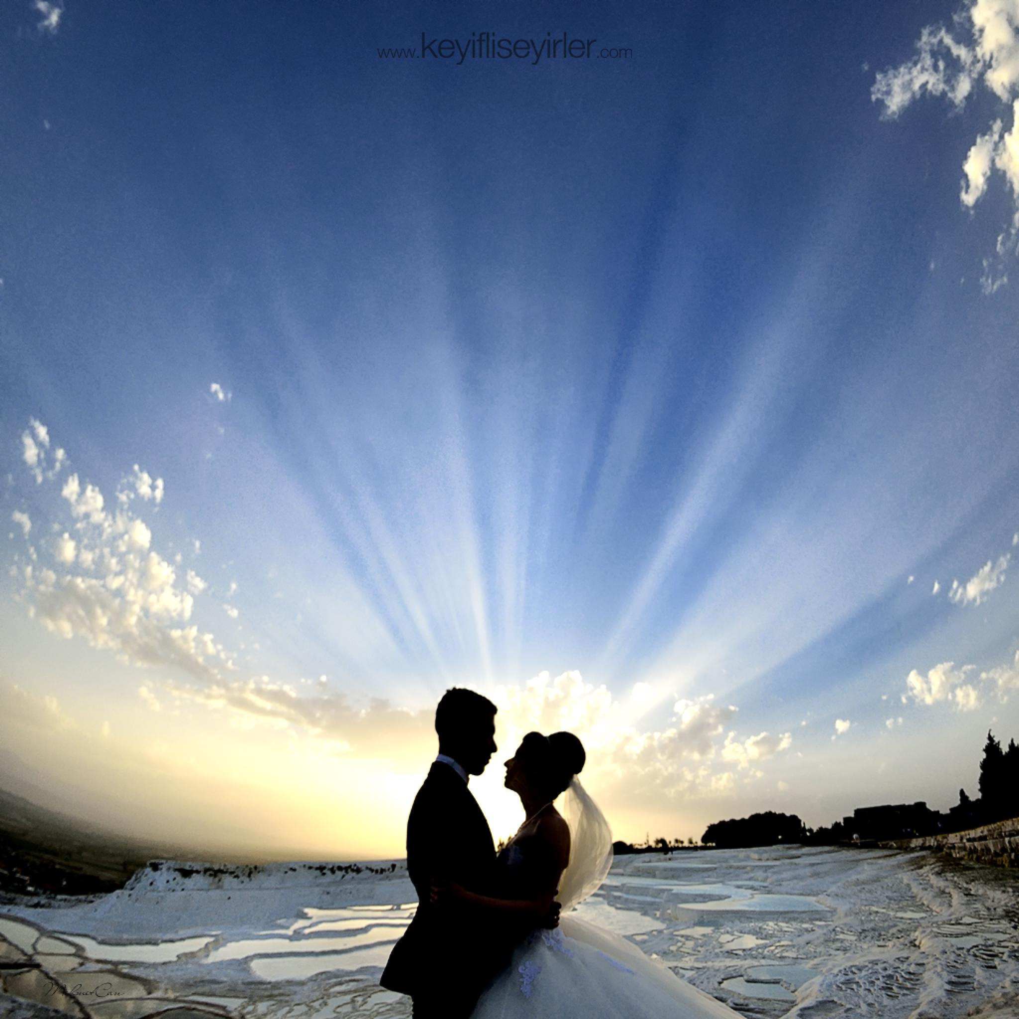 sunset wedding couple by Mehmet Can