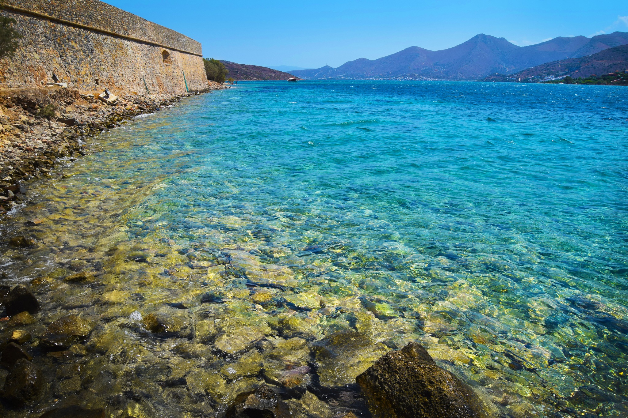 Crystal Clear Waters At Spinalonga by MollyGreenPhotography