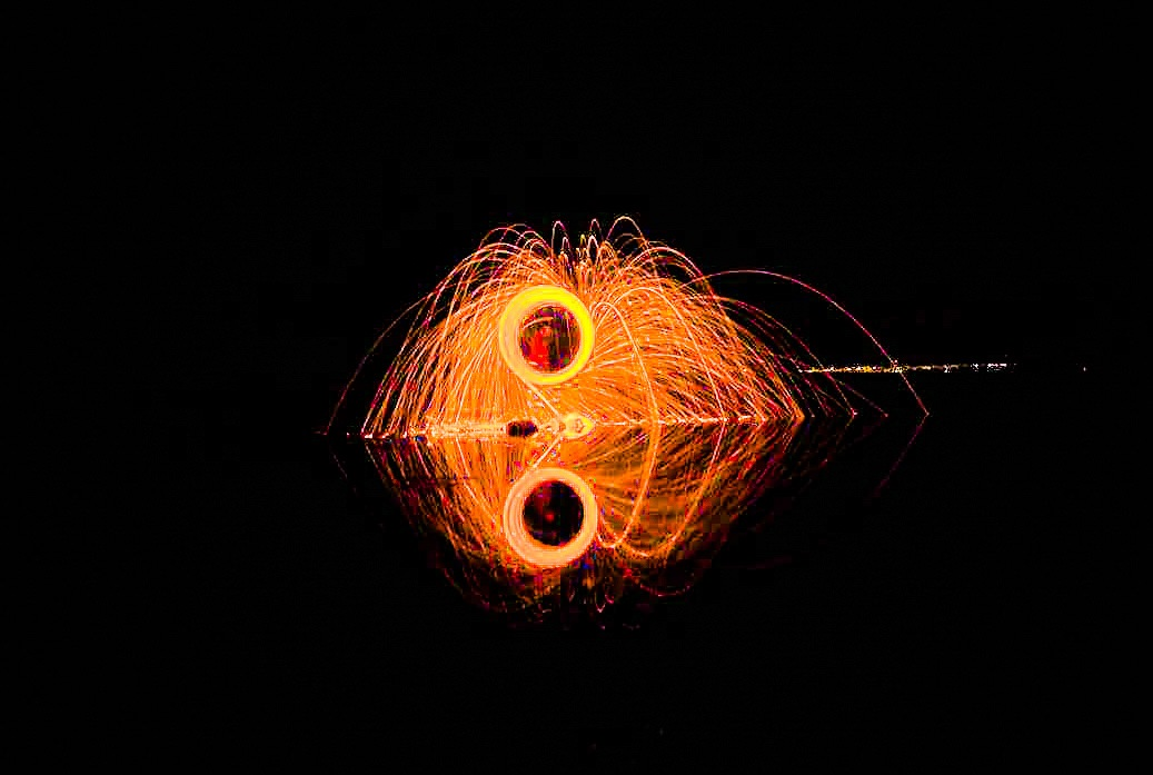 fire wheel with reflection by Darren Walton Photography