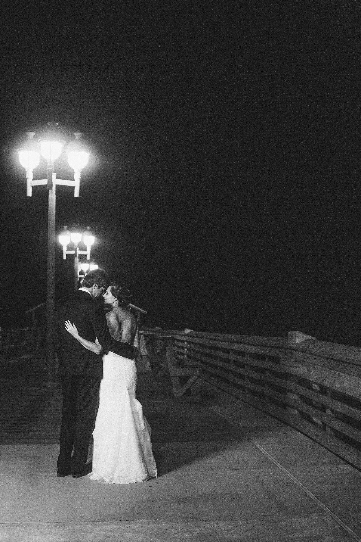 Jennette's Pier Coastal Beach Classic Black Wedding | Outer Banks Wedding Photographer. by andrewandtianna
