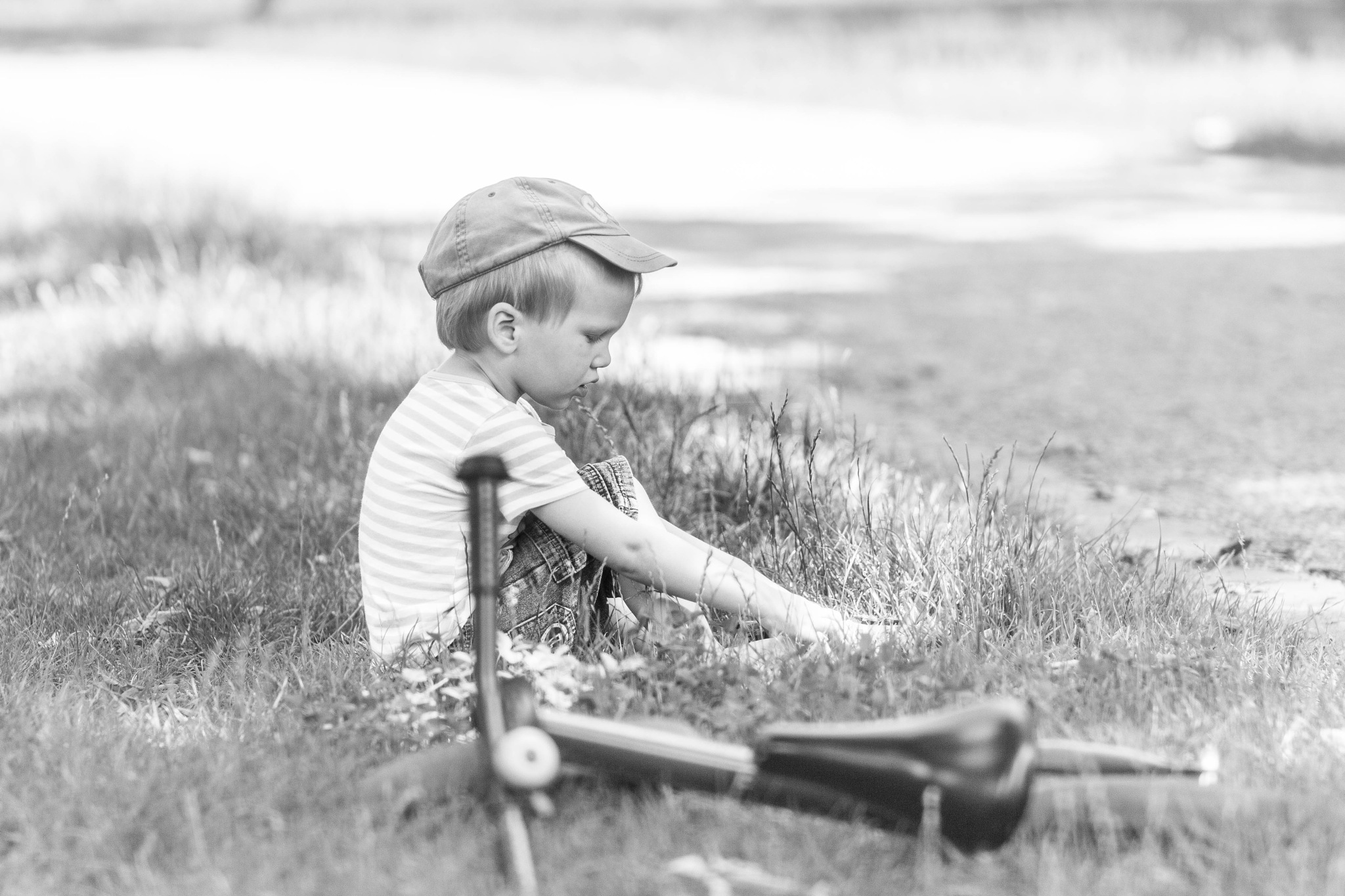 Little boy with his Bicycle by Márton Csordás