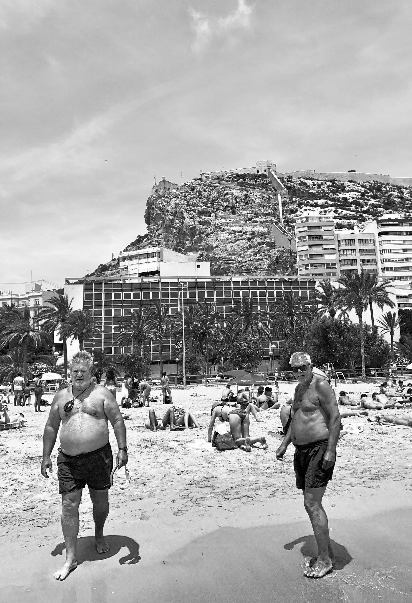 Two men on playa Postiguet, Alicante  by Duane Bridger