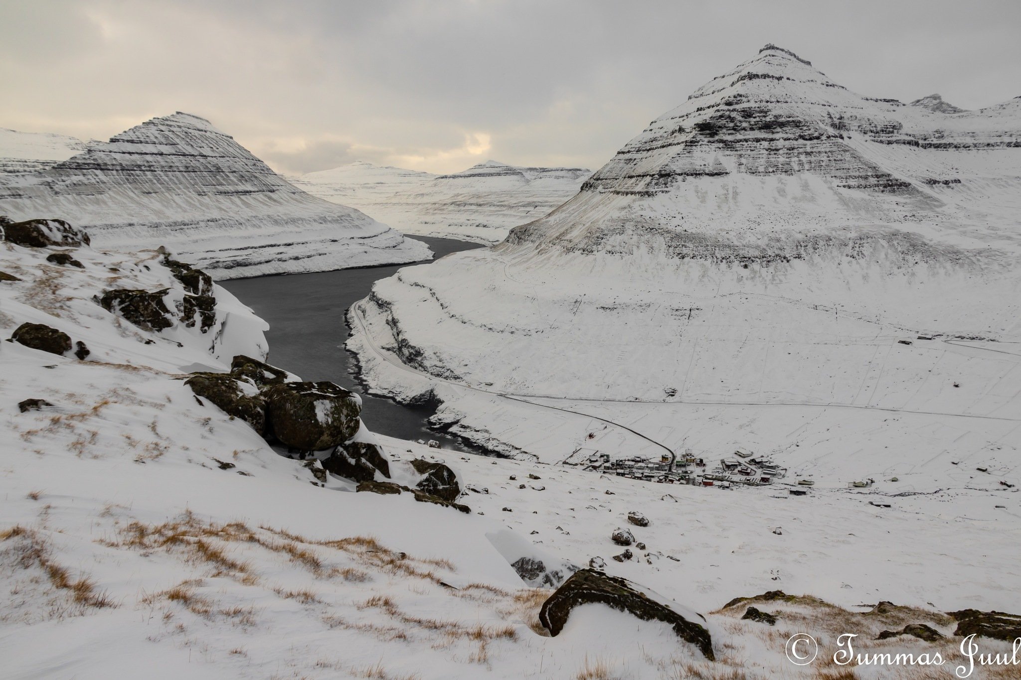 Photo in Landscape #nature #winter #snow #cold #mountain #cloudy #water #atlantic #north #faroe islands #eysturoy #rock #cliffs #ridge #above