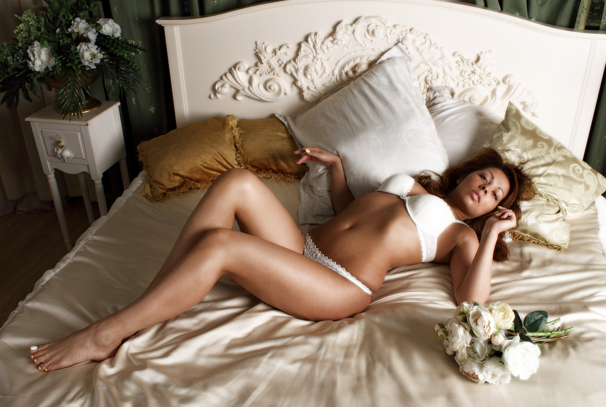 Girl in bra and panties with flowers on a bed by Lightspear