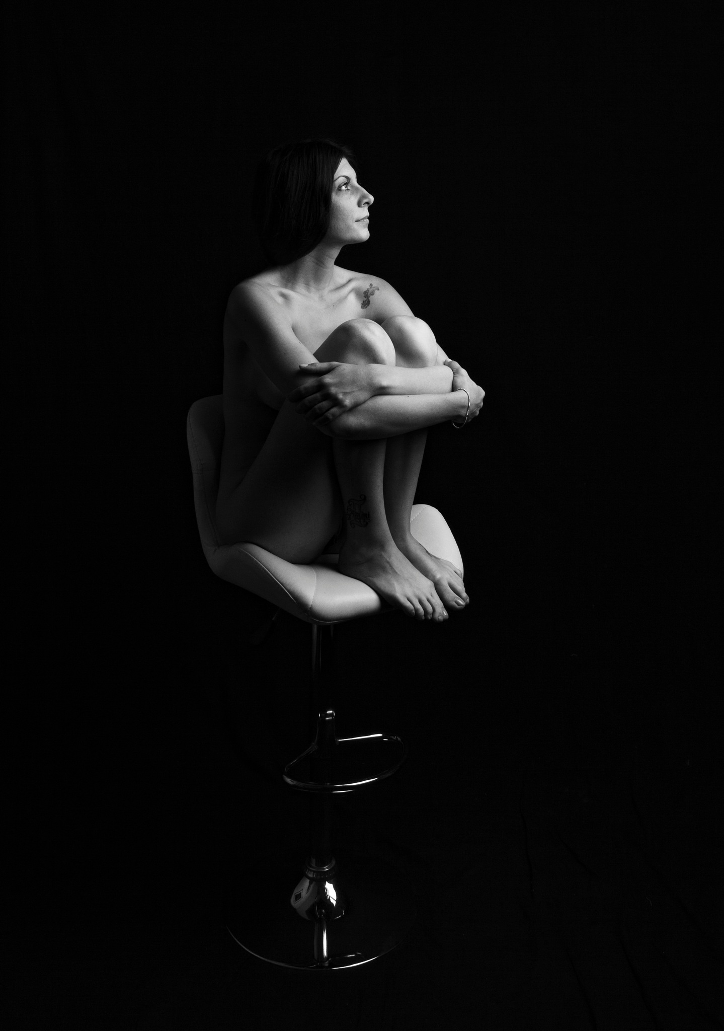 Nude on big chair by Orr Patrick Nir
