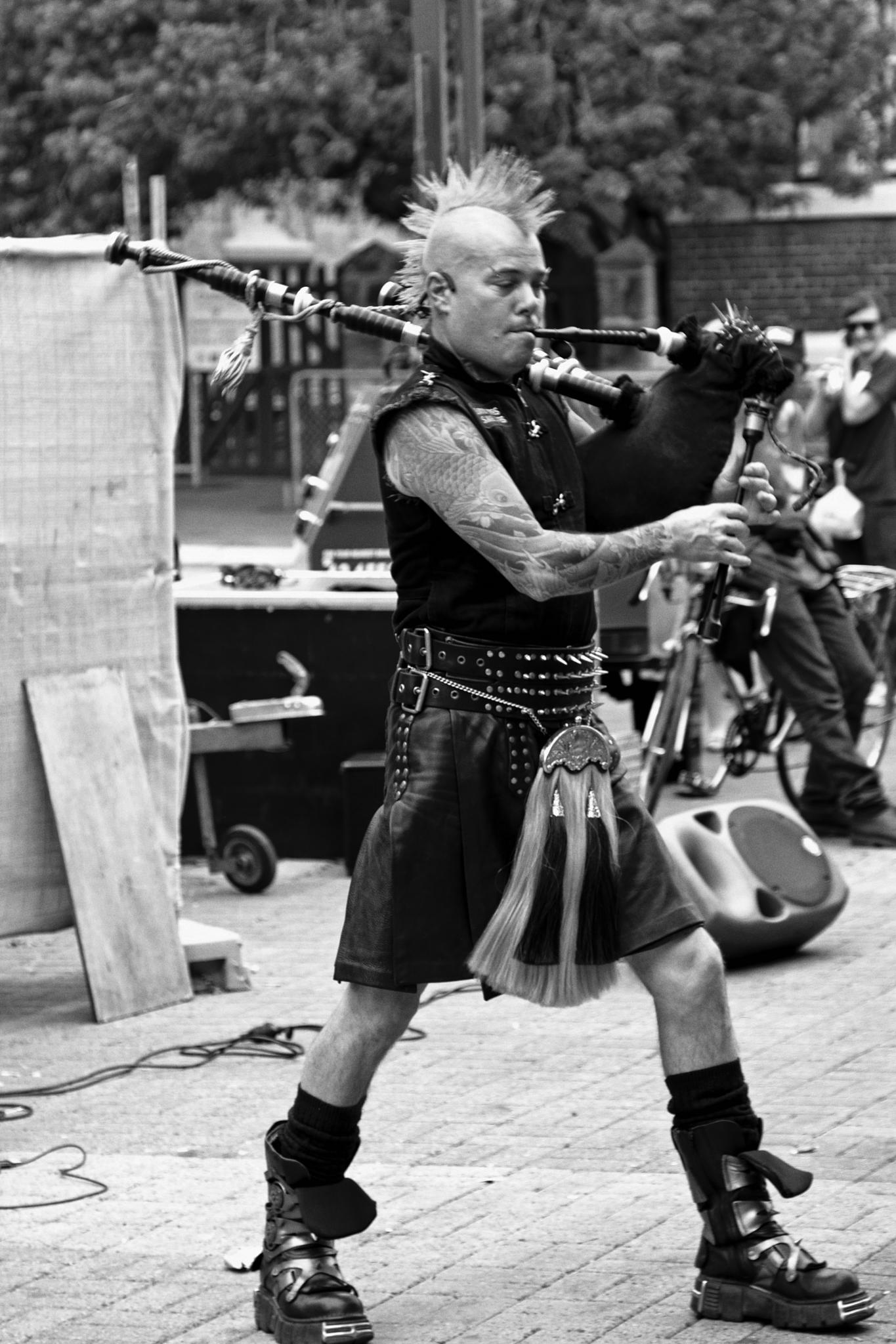 AC/DC Bagpipe Street Musician by Tony Shaw