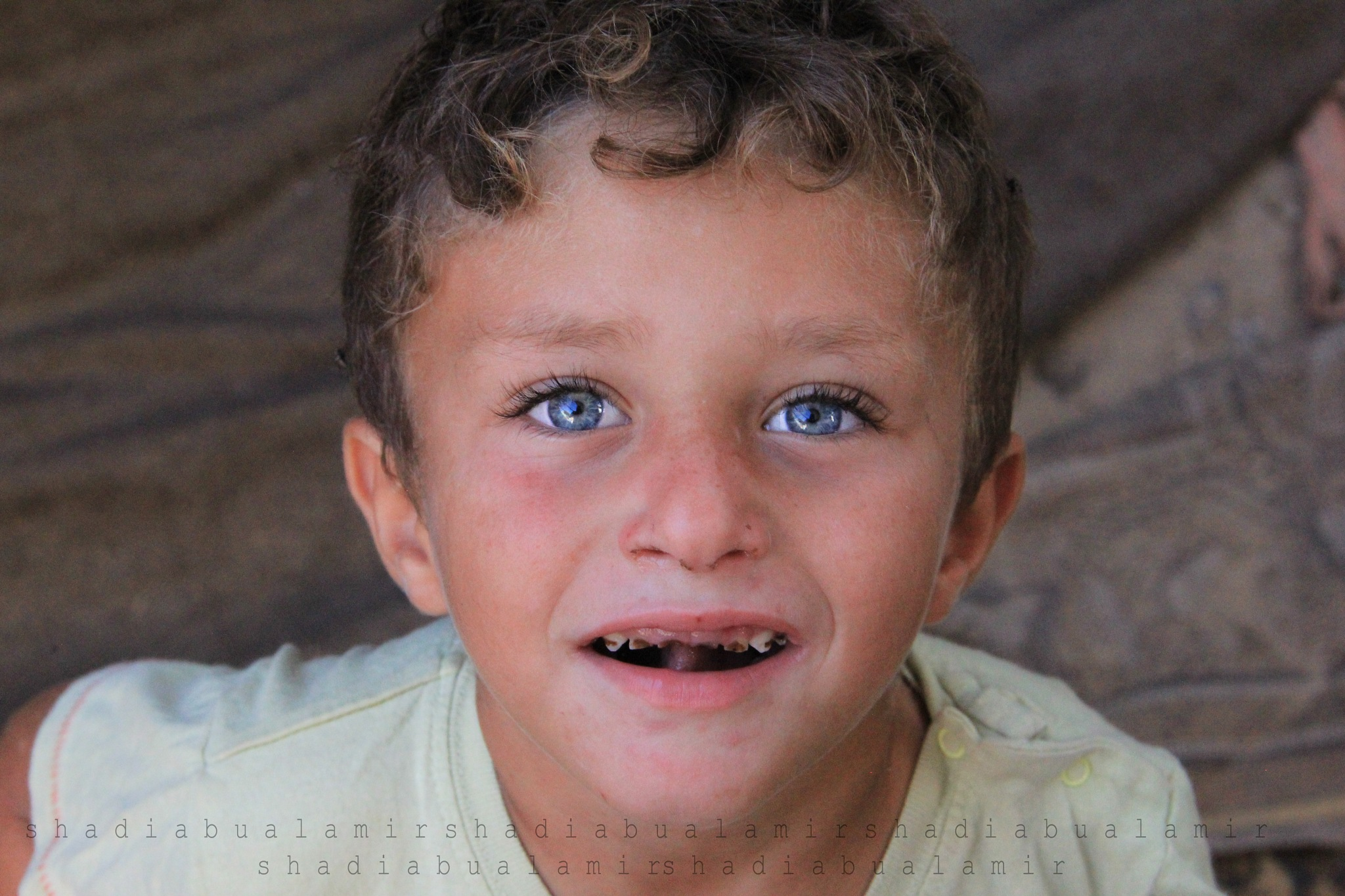 Poverty so ugly and the smile of the poor is so beautiful by Shadi Abu Al Amir