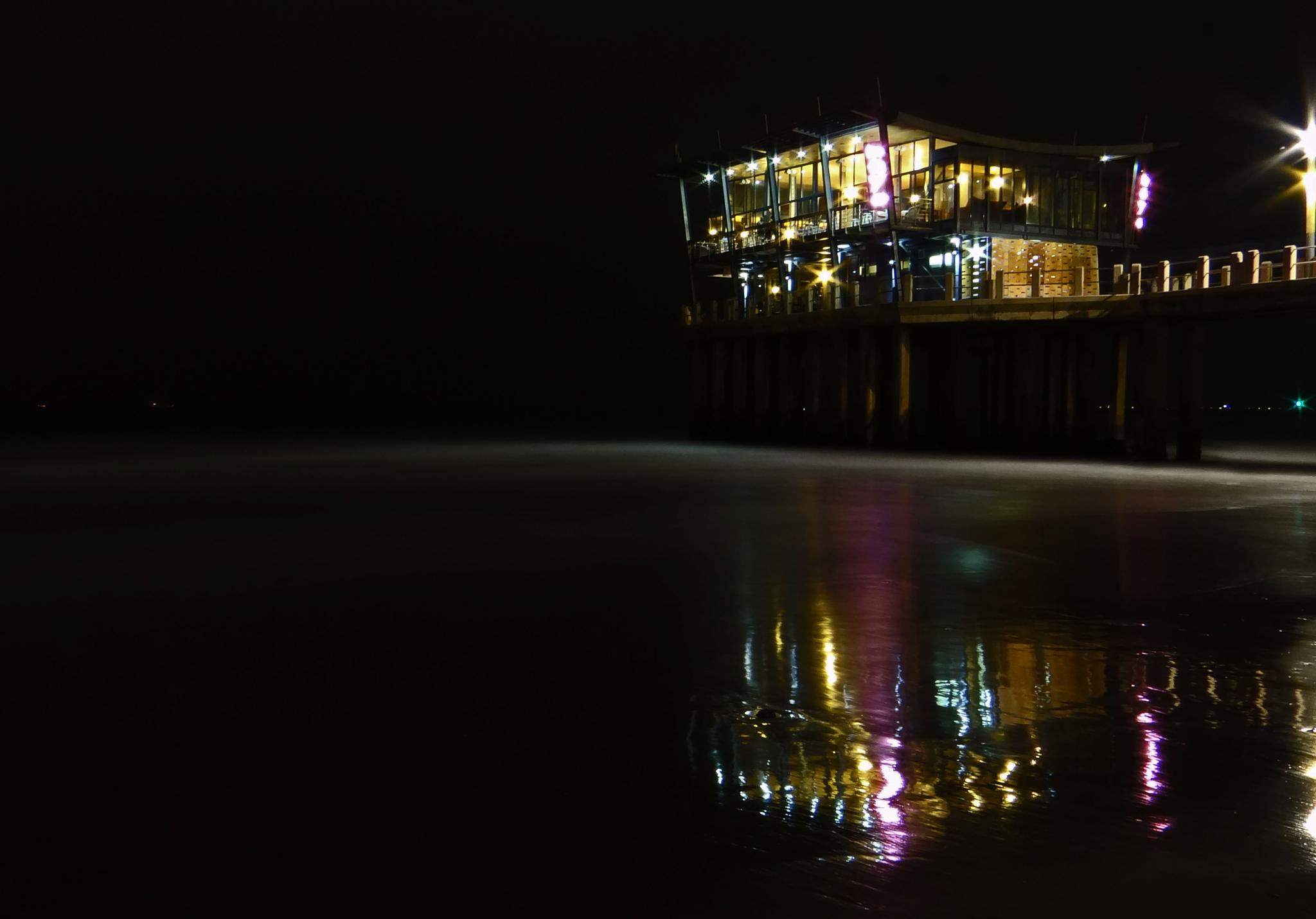 reflections of Moyo Pier by Lee-Ann Conway
