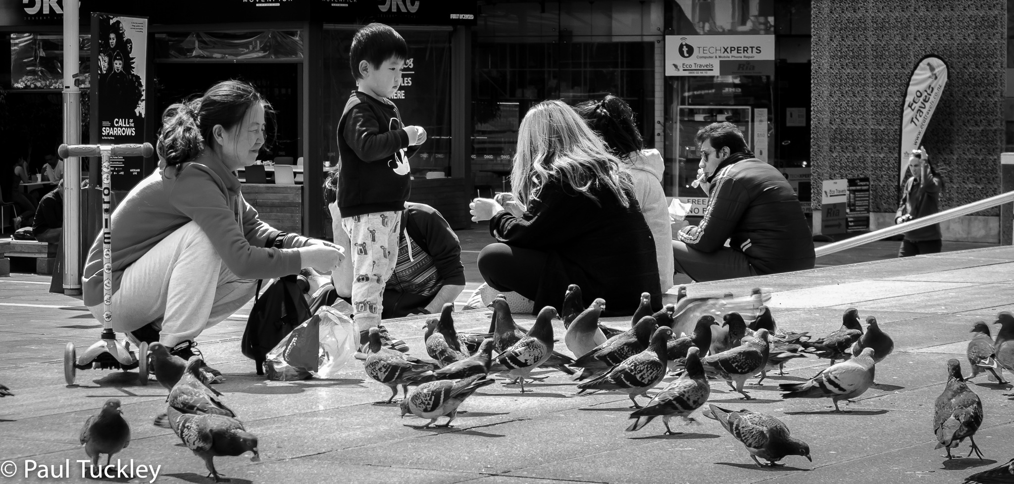 Feeding the pigeons with mum by Paul Tuckley