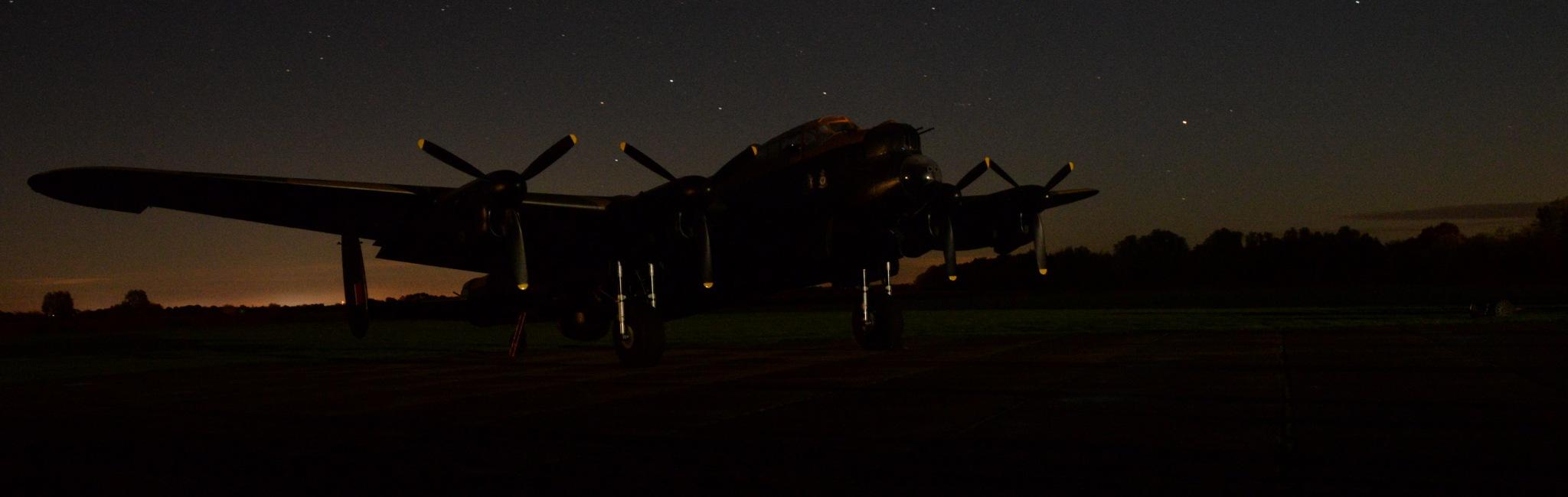 Lancaster Bomber against the sunset and stars by trevvie_uk