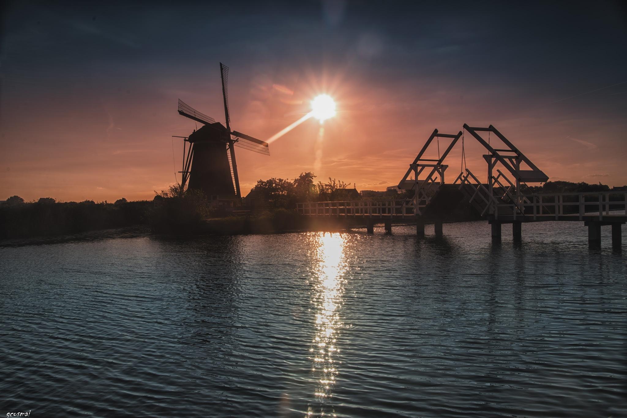 Sunset, windmill and a bridge by G.Cosmai