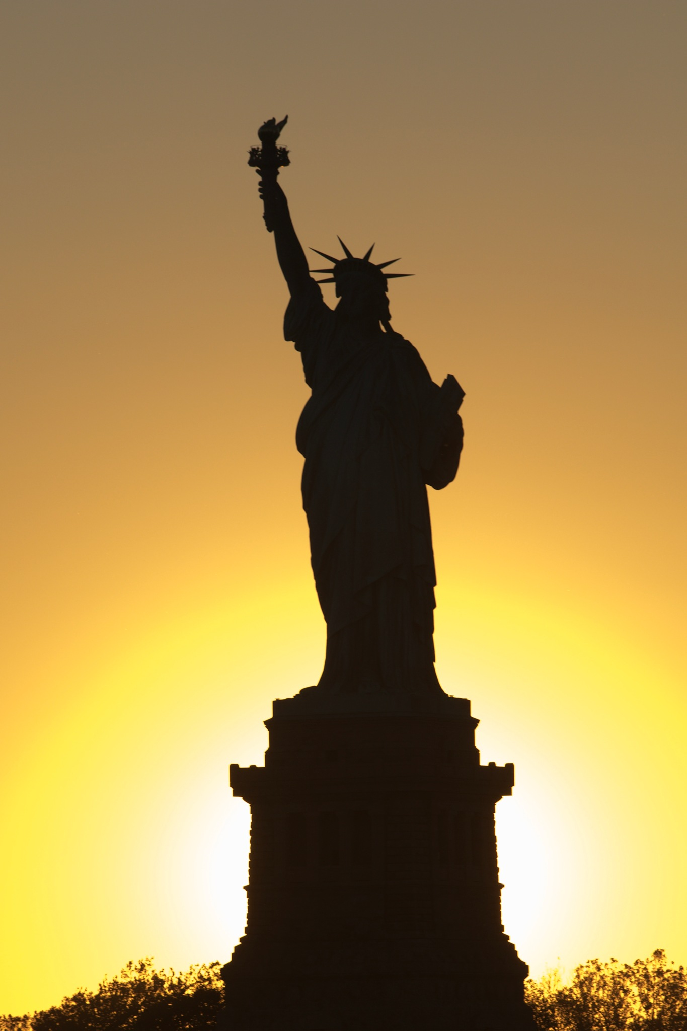 Sun Setting on Lady Liberty by James Eaton