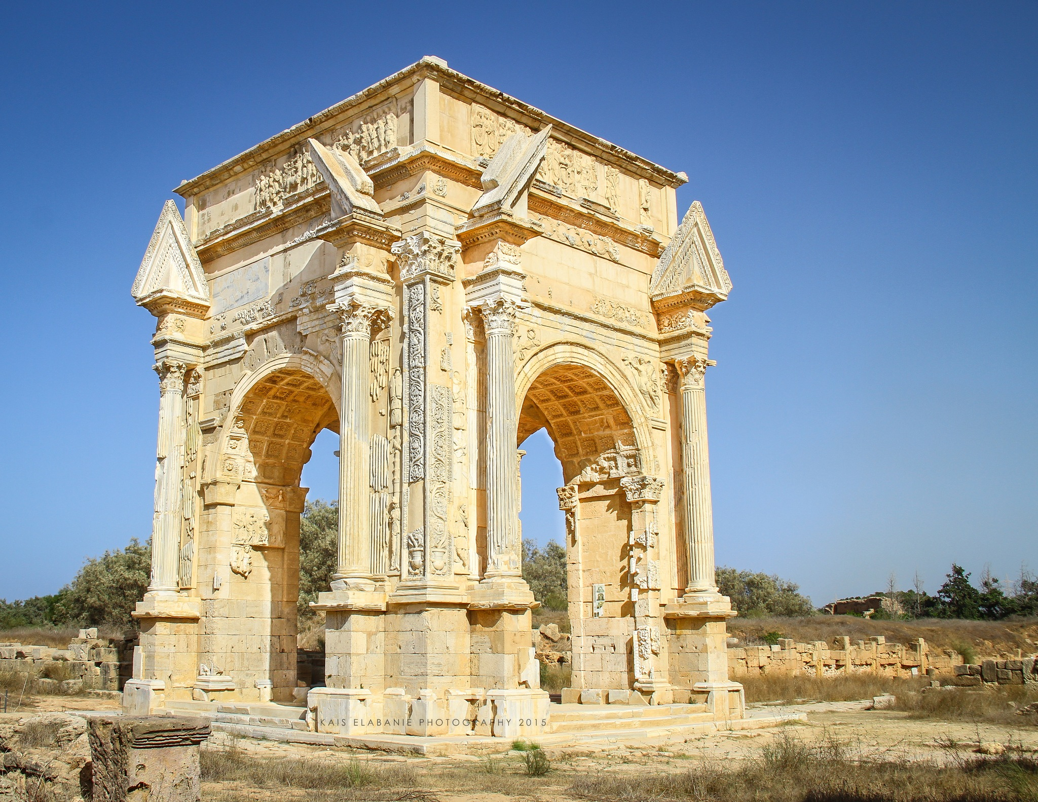 The Arch of Septimius Severus at Leptis Magna by Kais Elabanie