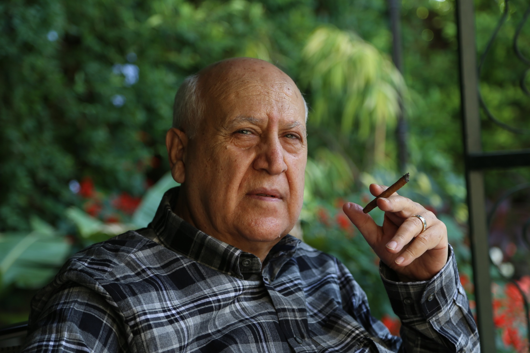 Enjoying a cigarillo by Tawfik W Dajani