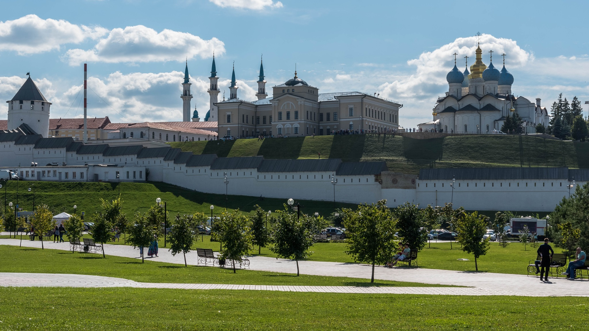 Christian church and Mosque next to each other by Vadim Chepegin