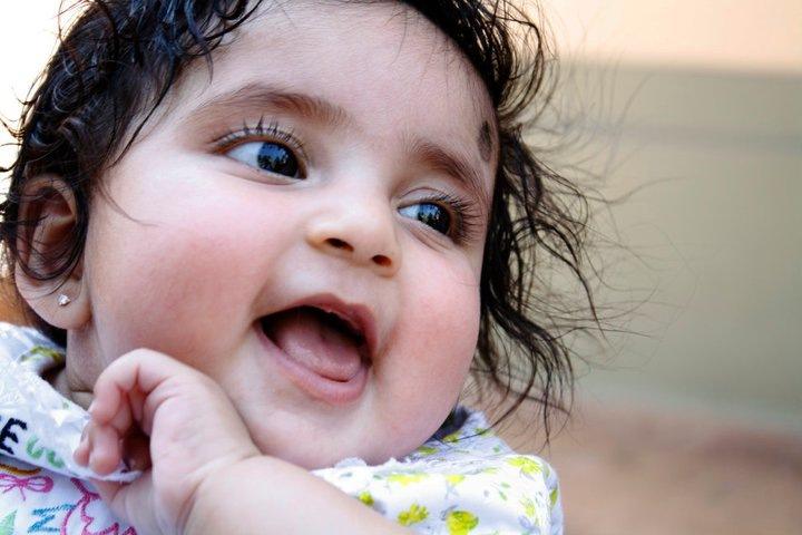 Smile of innocence... by Mithun V Menon
