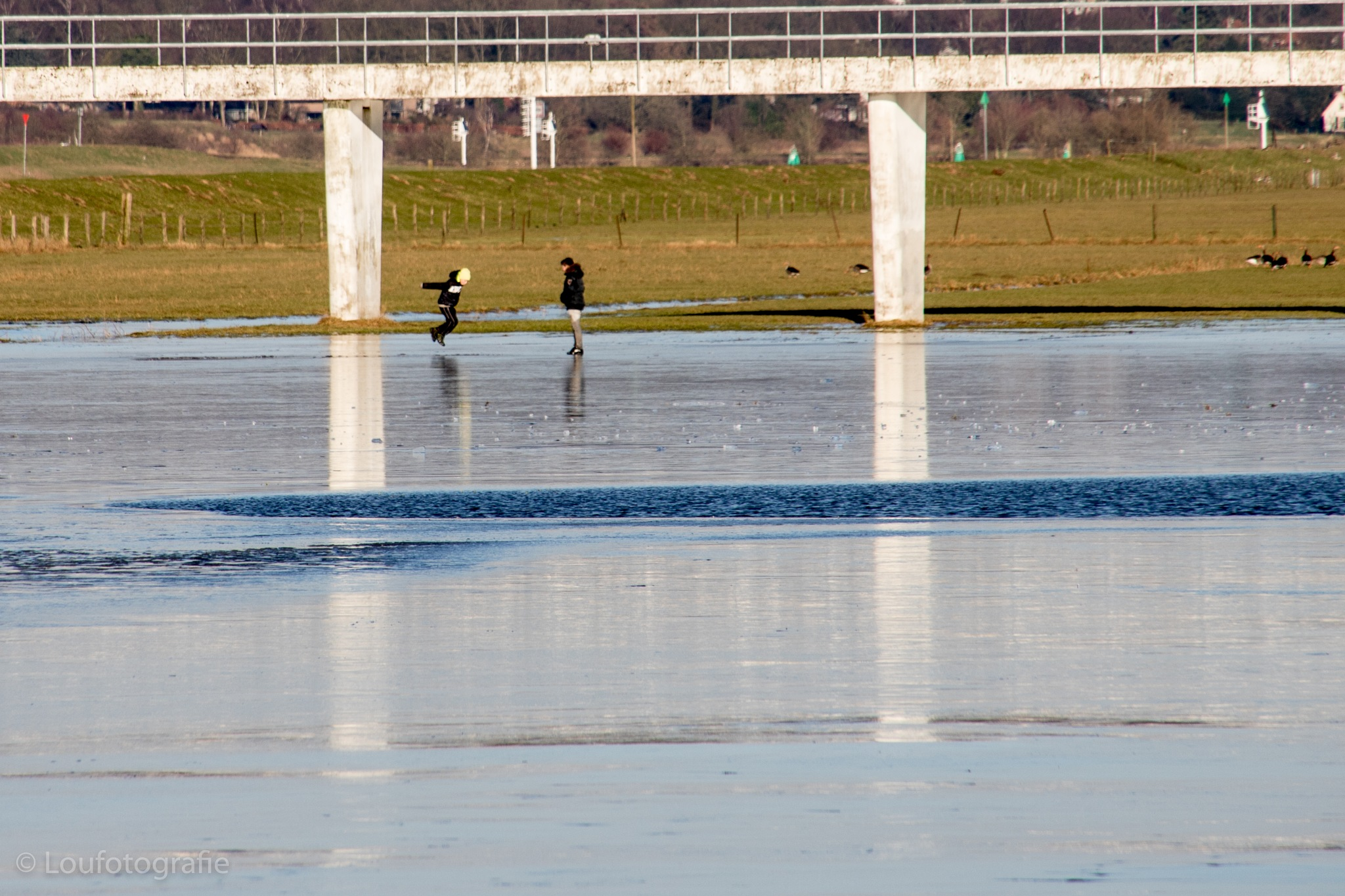 Jumping on the ice - Yssel Nederland  by Loufotografie