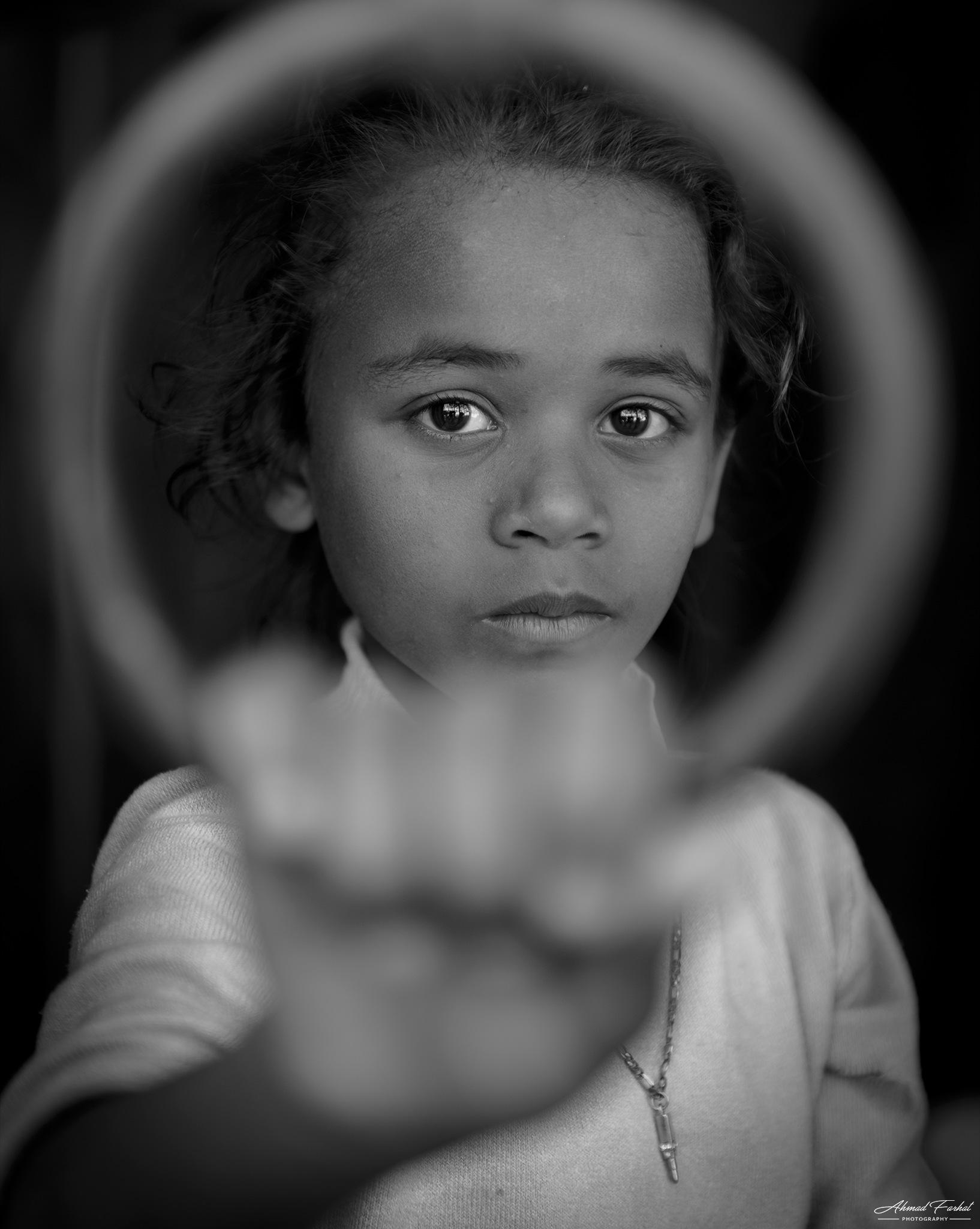 A girl in the street by Ahmad Farhat