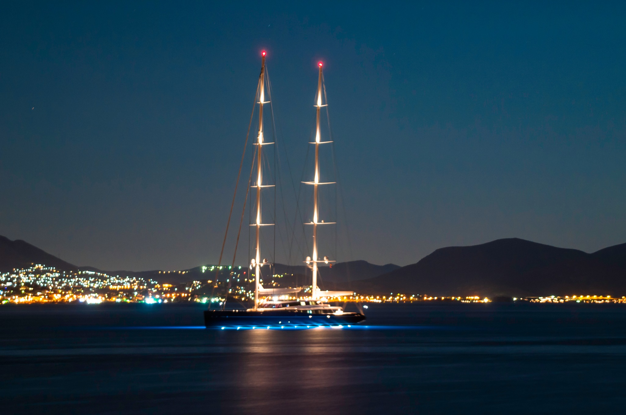 Ship with sails at night by stratos