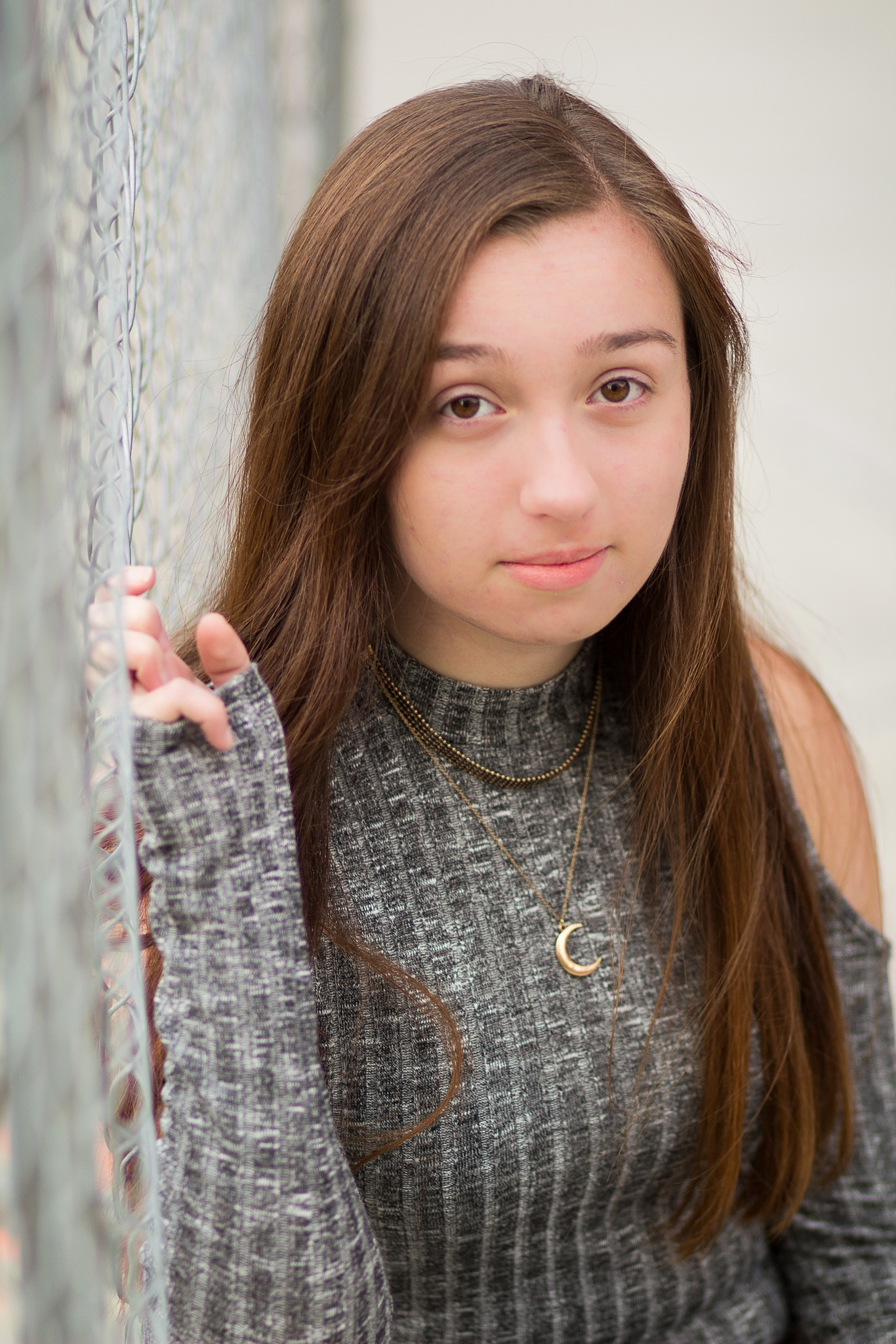 Anna Leaning on Chain link fence by Monique DeLay Gartner