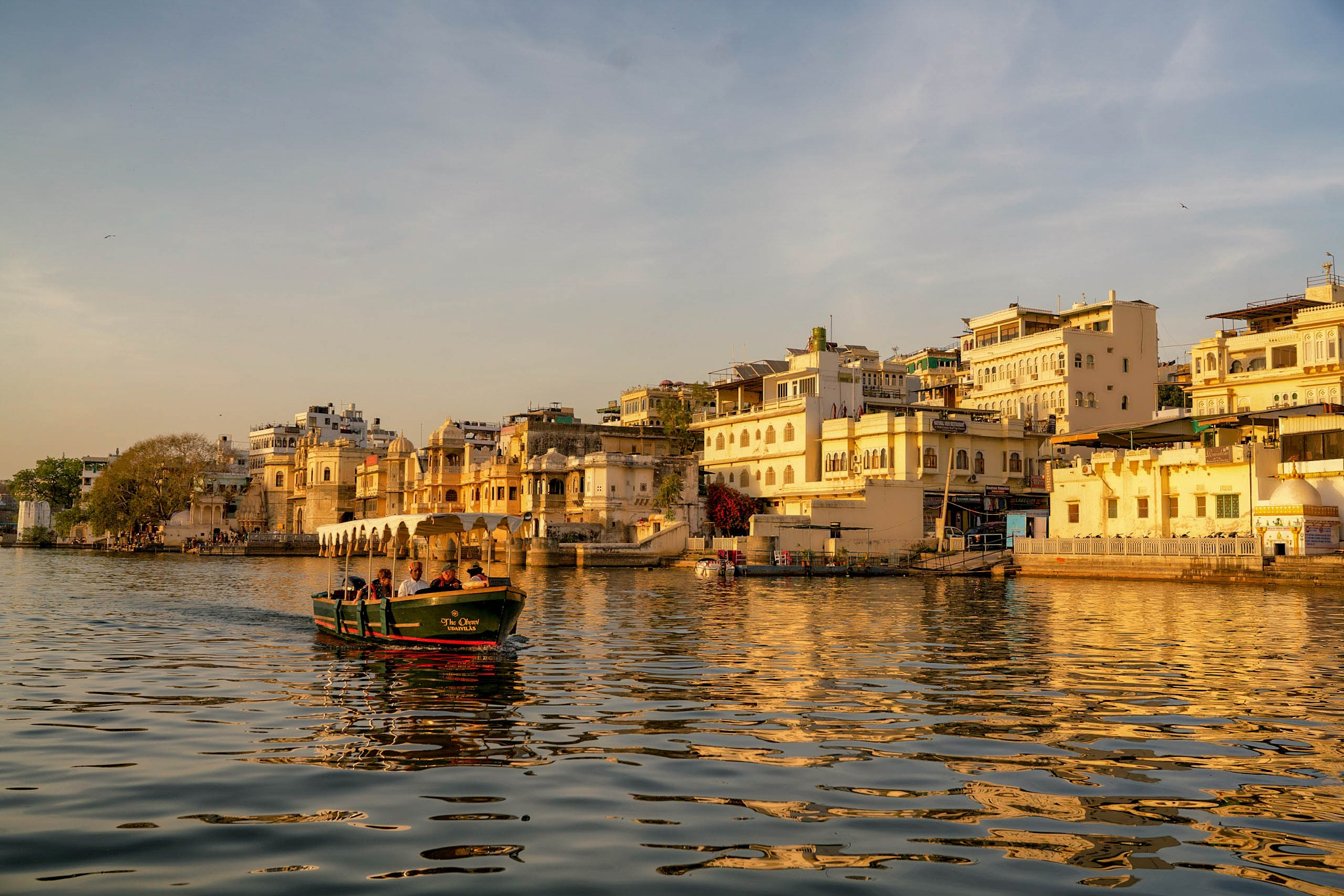 Boat on a lake, Udaipur, India. by Peter Holton