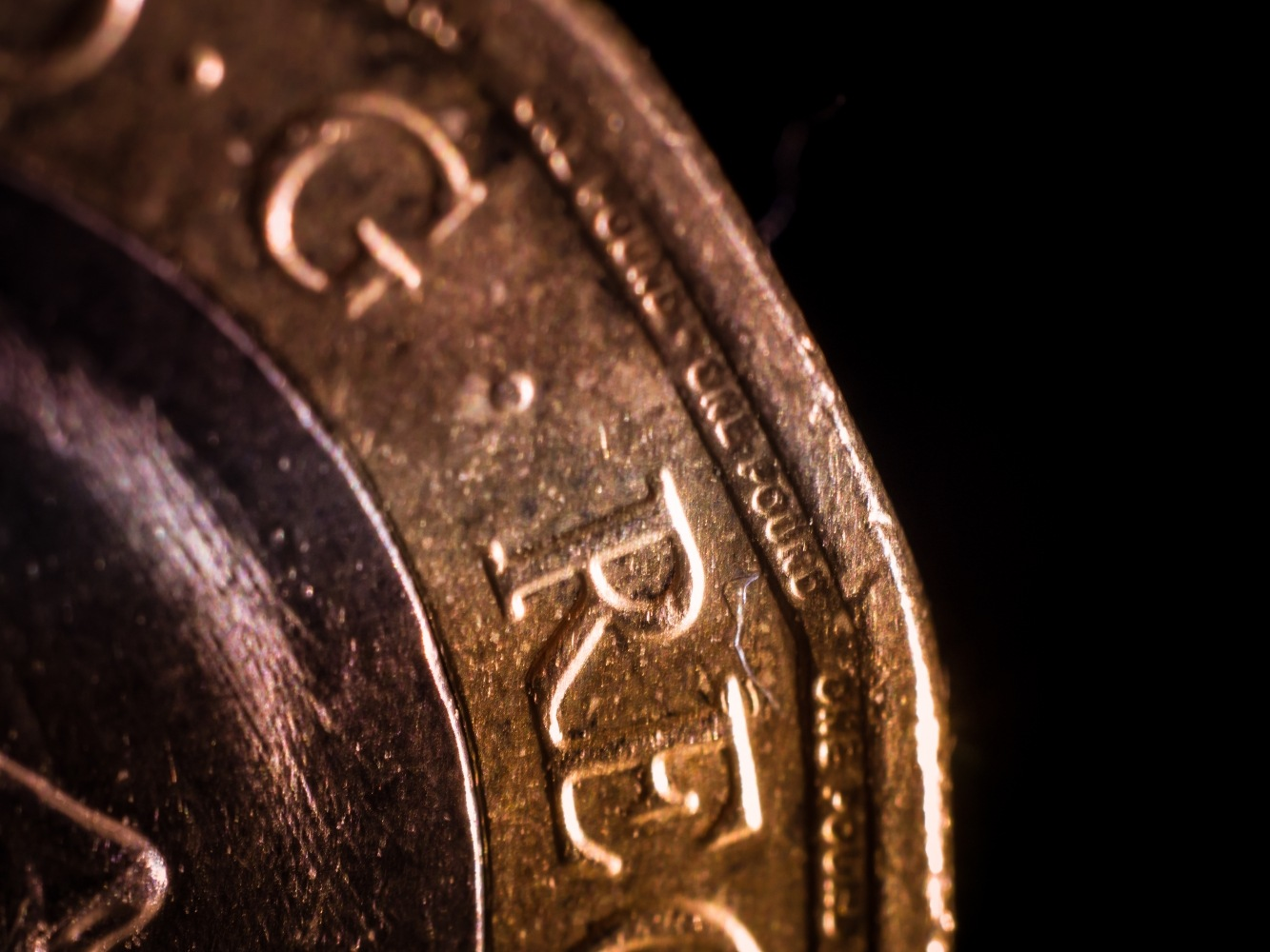 Macro pound coin by draycottphotography