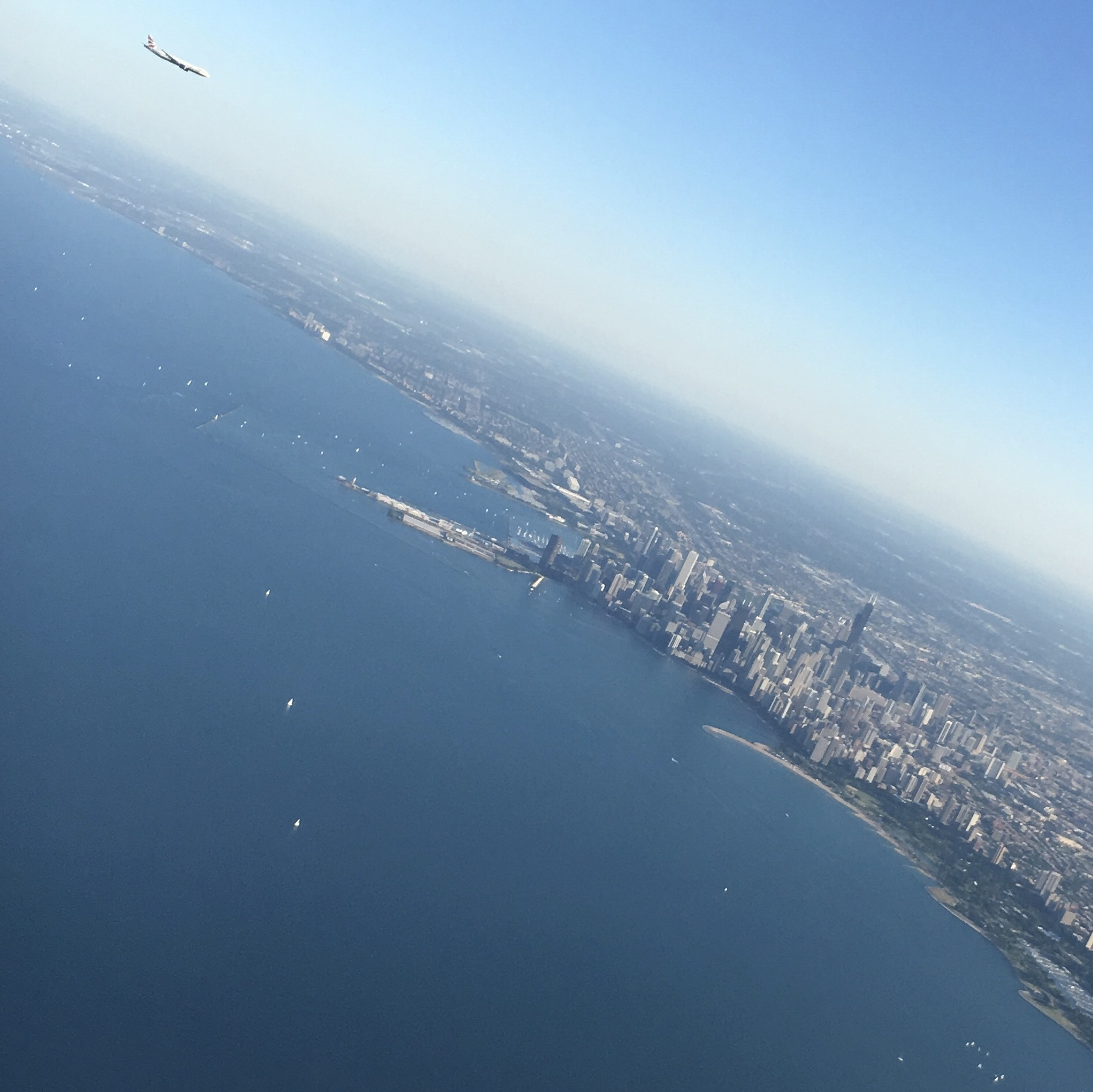 Photo taken from a plane with another plane on the left landing in Chicago. by hazemalwajeeh13