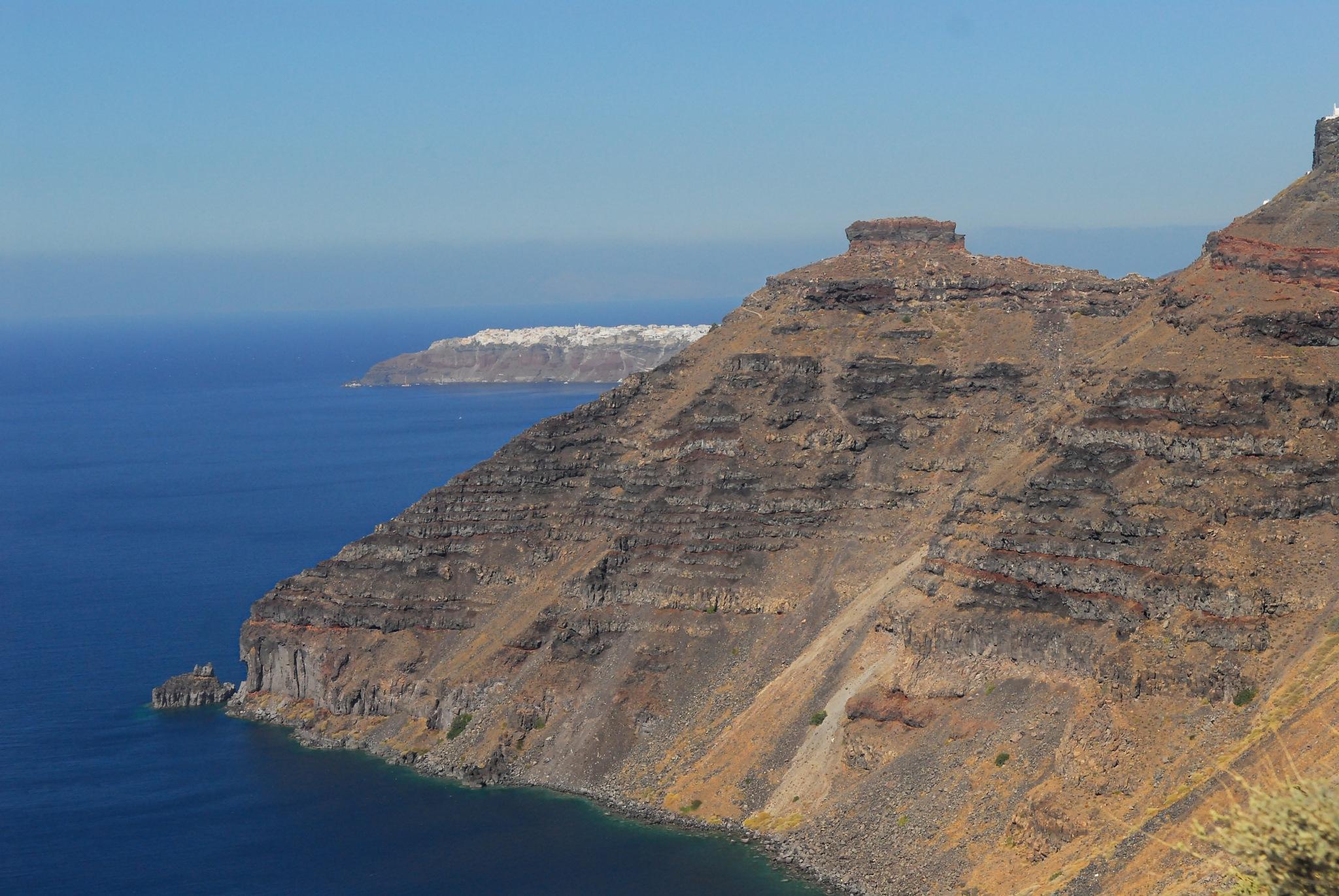 SANTORINI.  View of Scaros from Akrotiri. by nadiakushnir