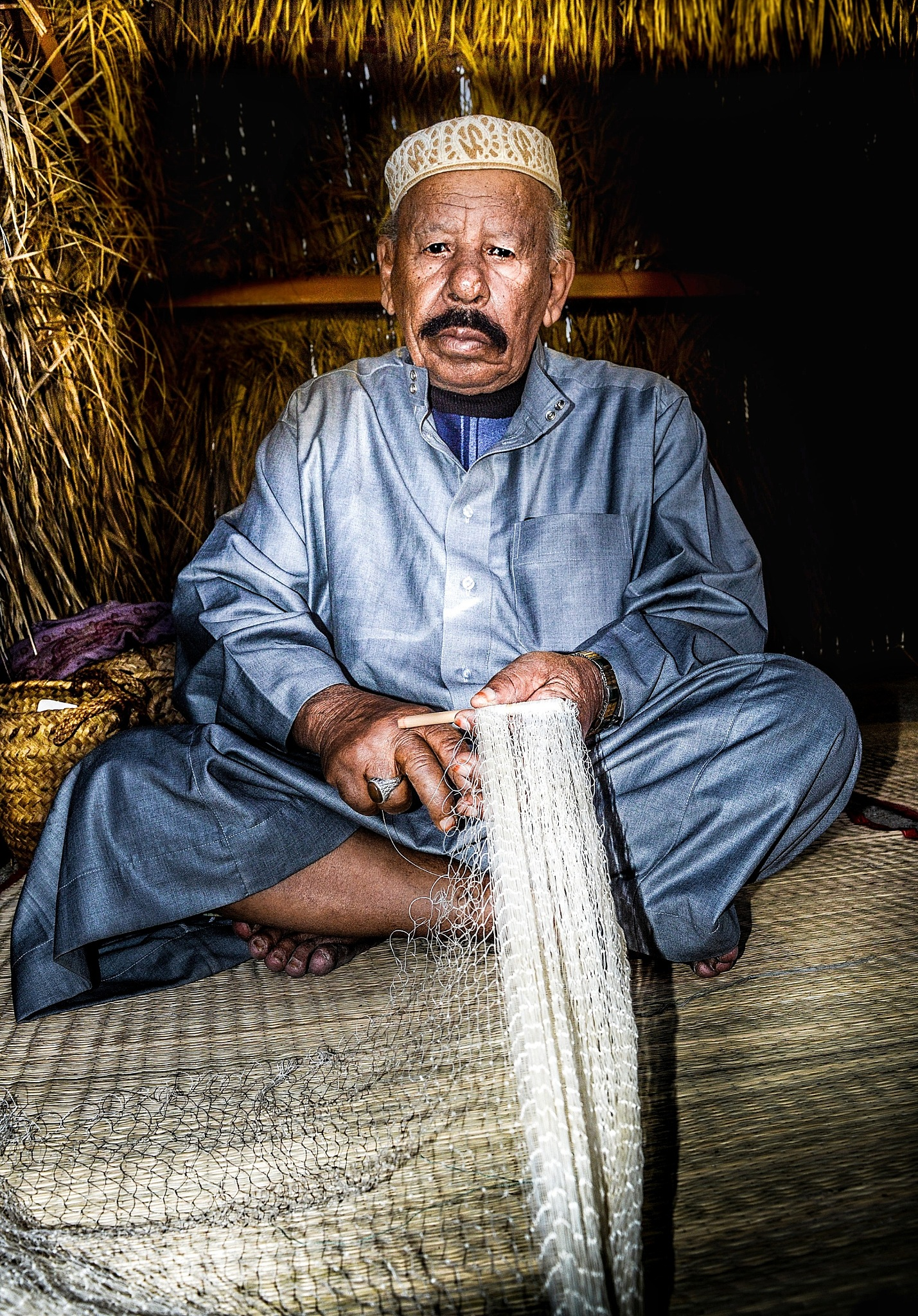Fishing nets makers. by Khaled Alazem