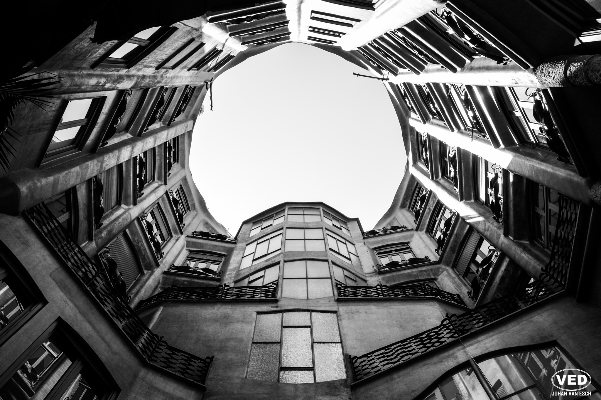 Photo in Architecture #sky #window #architecture #building #black and white #b&w #spain #barcelona #windows #courtyard #gaudi #la pedrera #casa mila #balcony