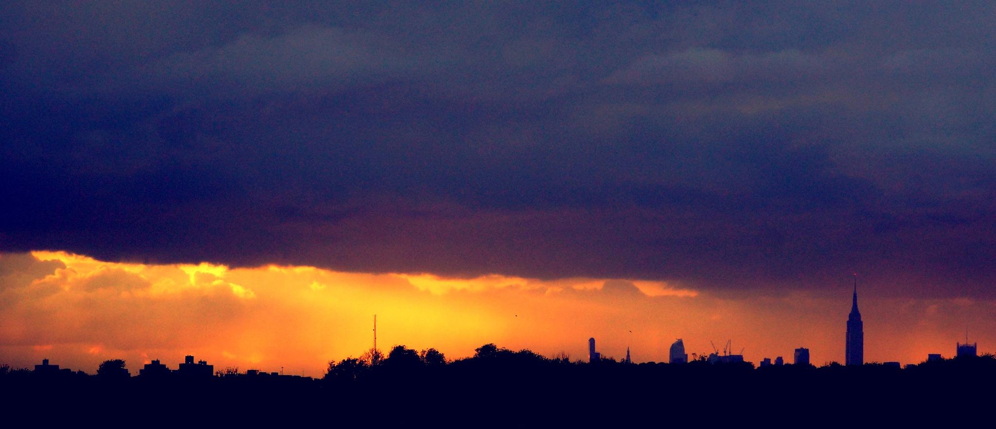 Storm Clouds over Manhattan by Troi Santos