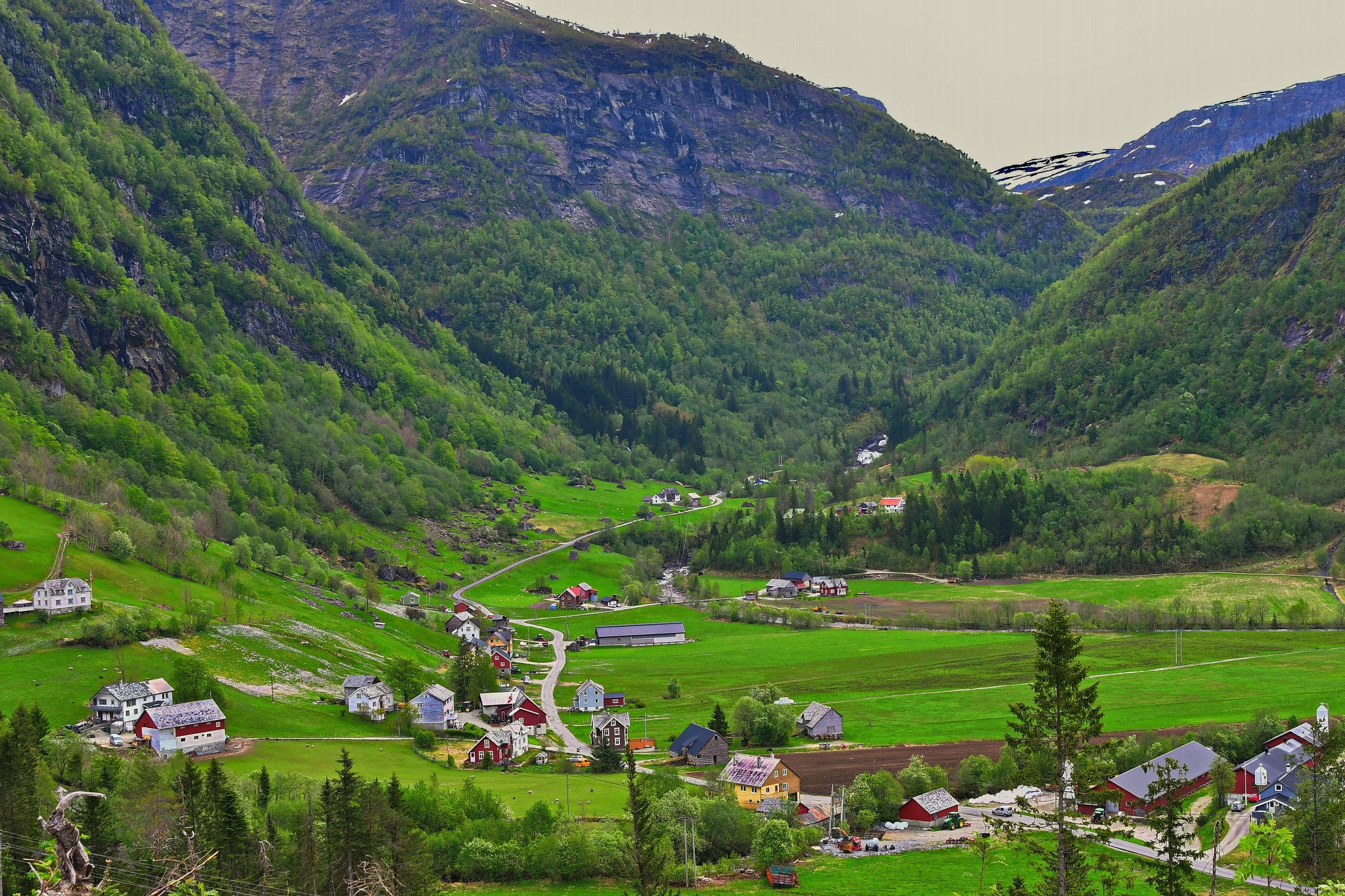 Farmers land between the mountains. by Per Molvik