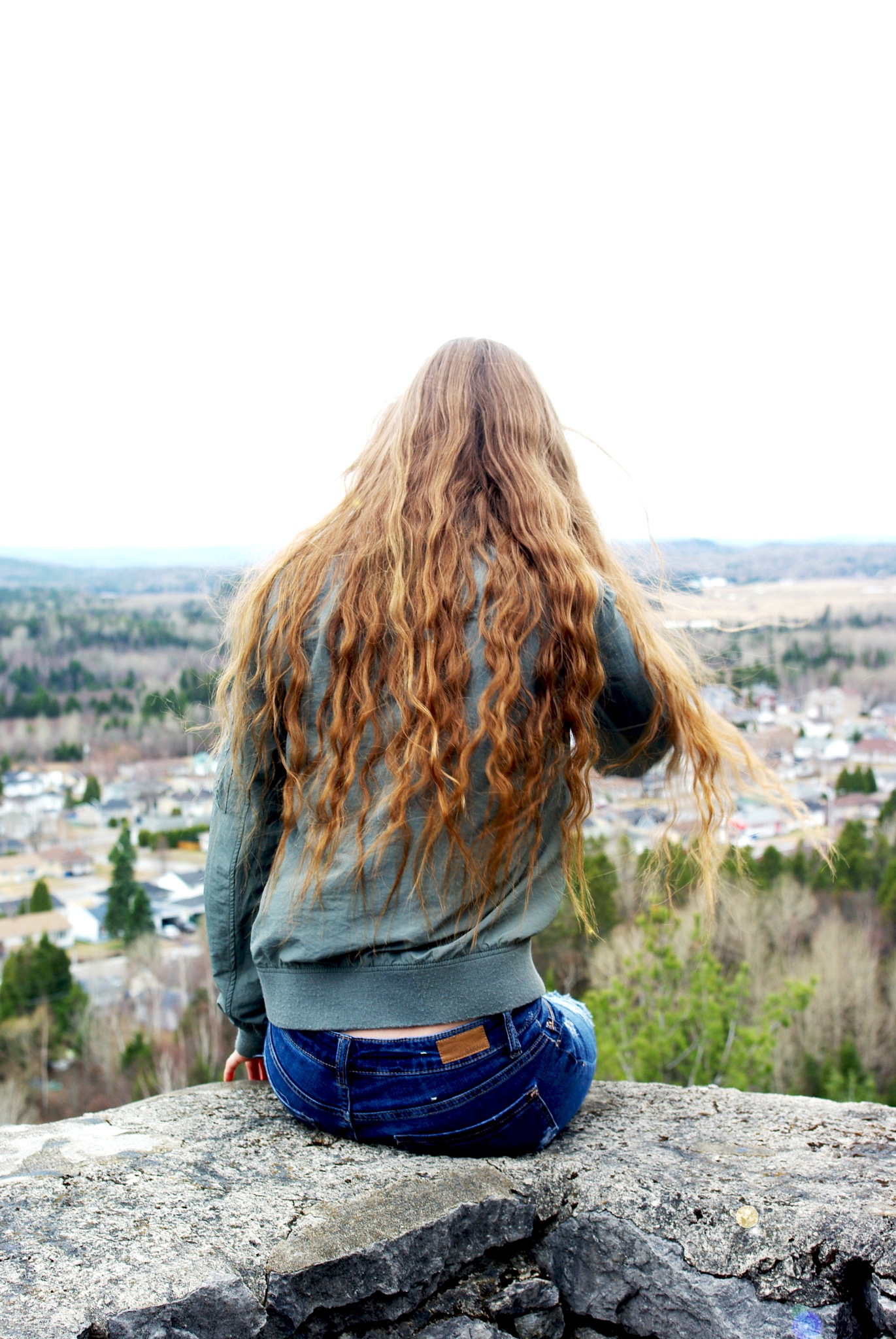 Girl Looking down the cliff. by Sam P.