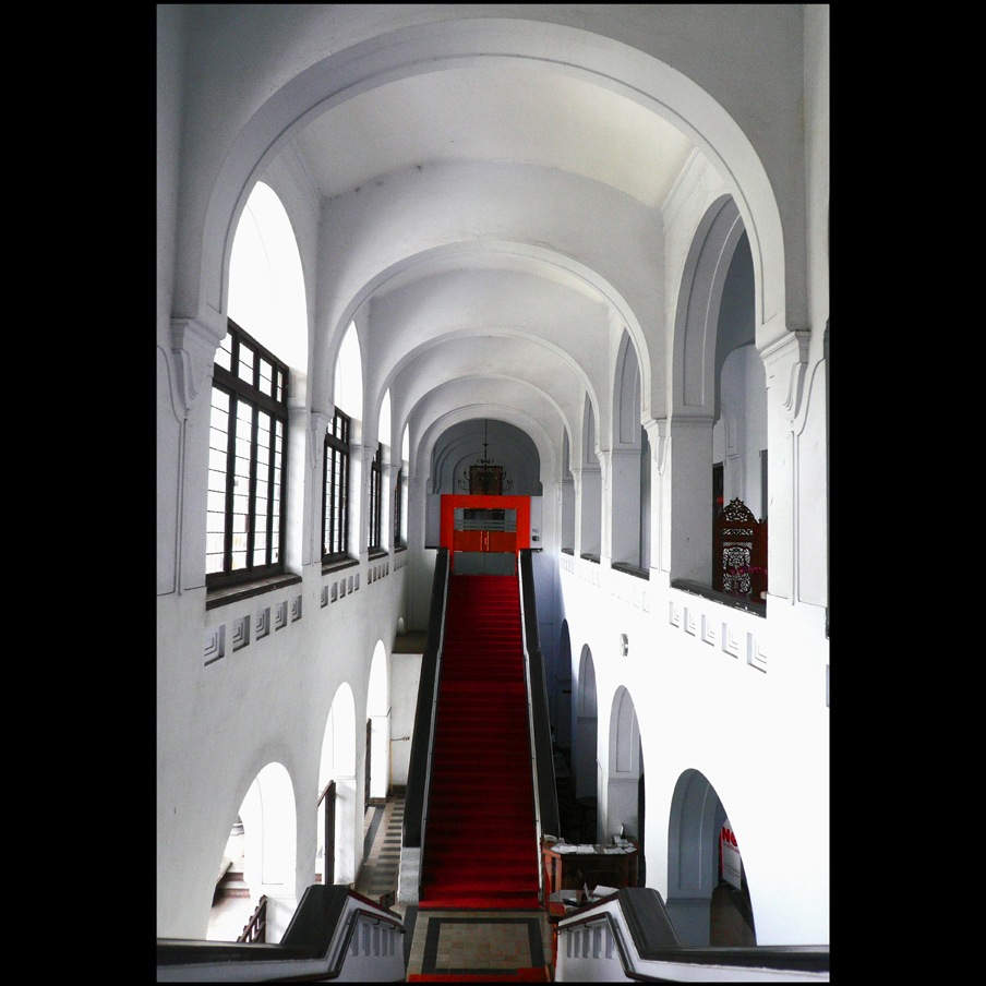 arches and red stairway. by anwarholid
