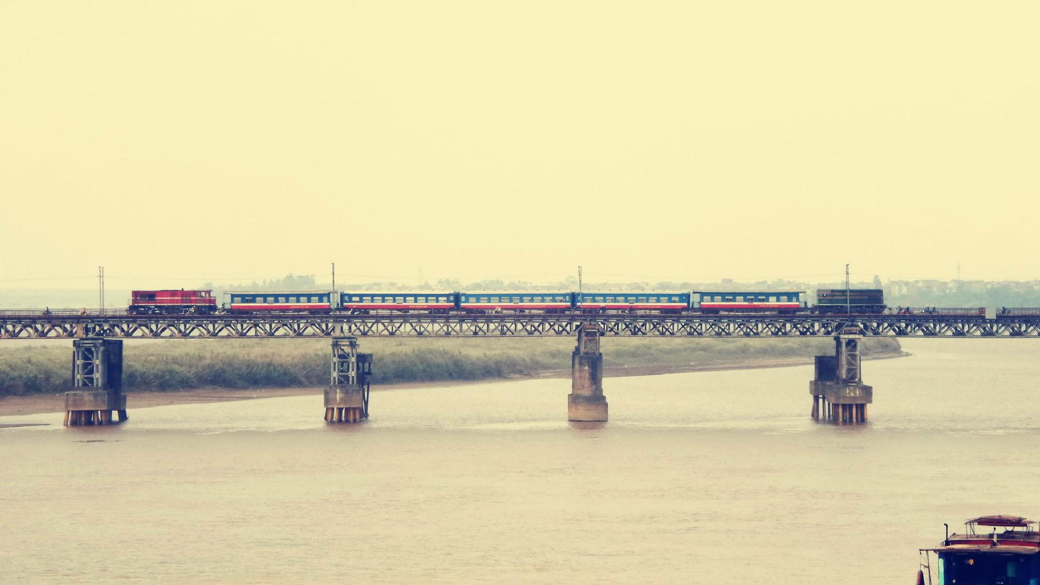 Train on Long Bien Bridge by Mars Ryan Hartdegen