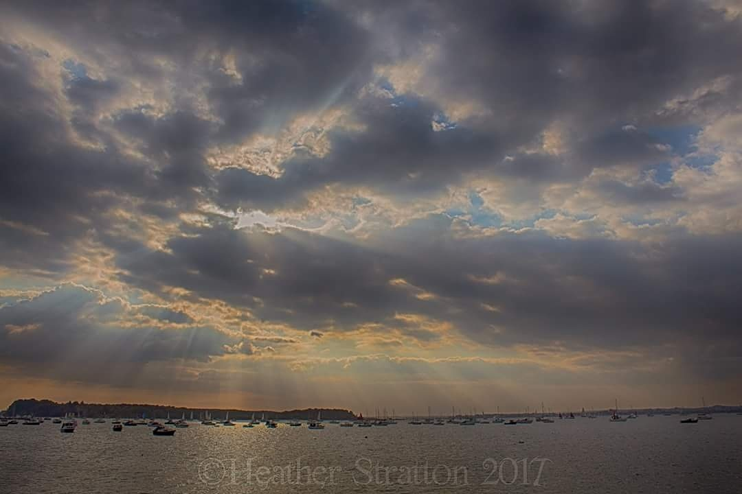 Poole harbour sunrays by Heather Stratton
