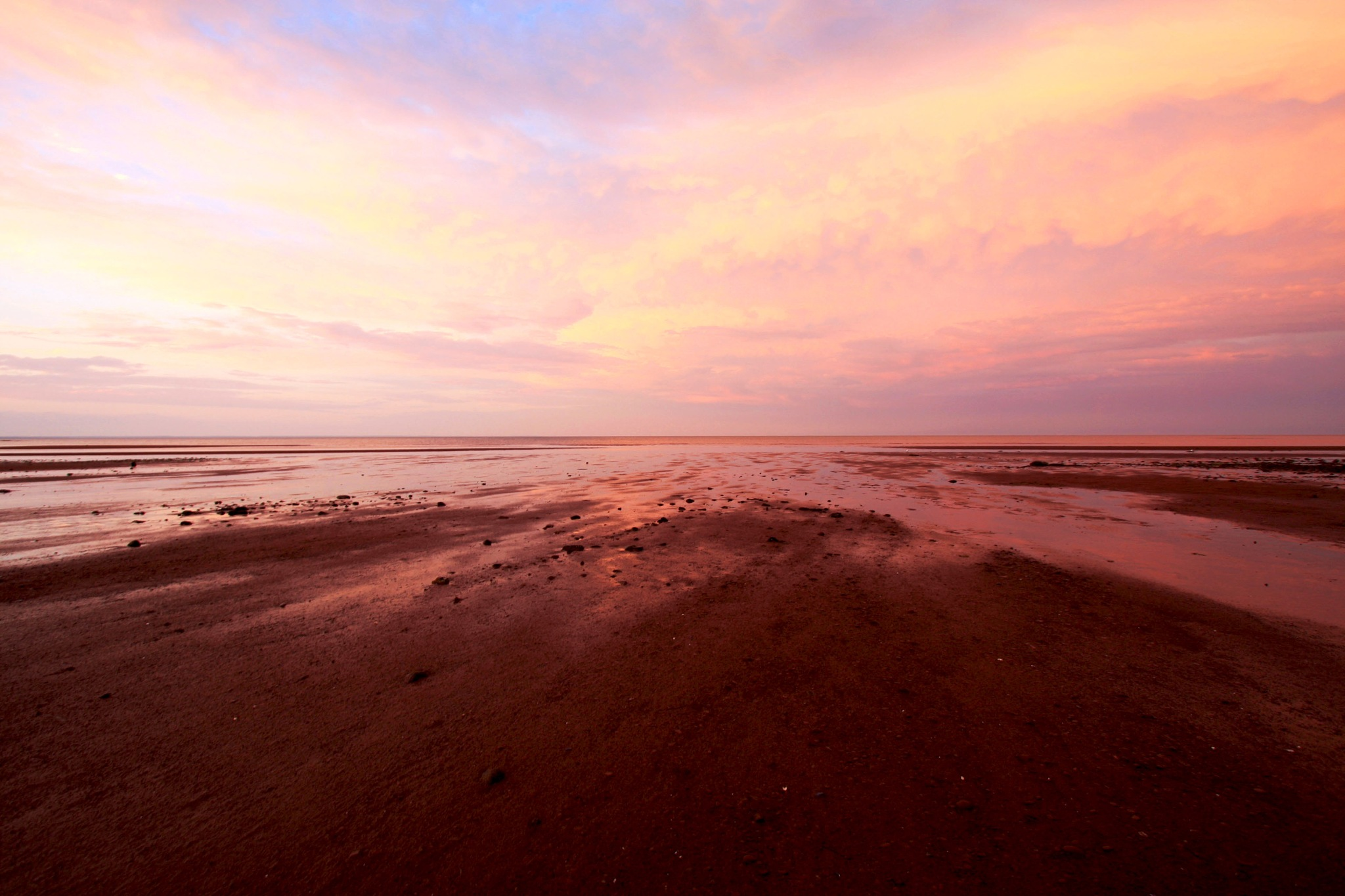 Red Sand Beach at Sunset by Wendy Farrington