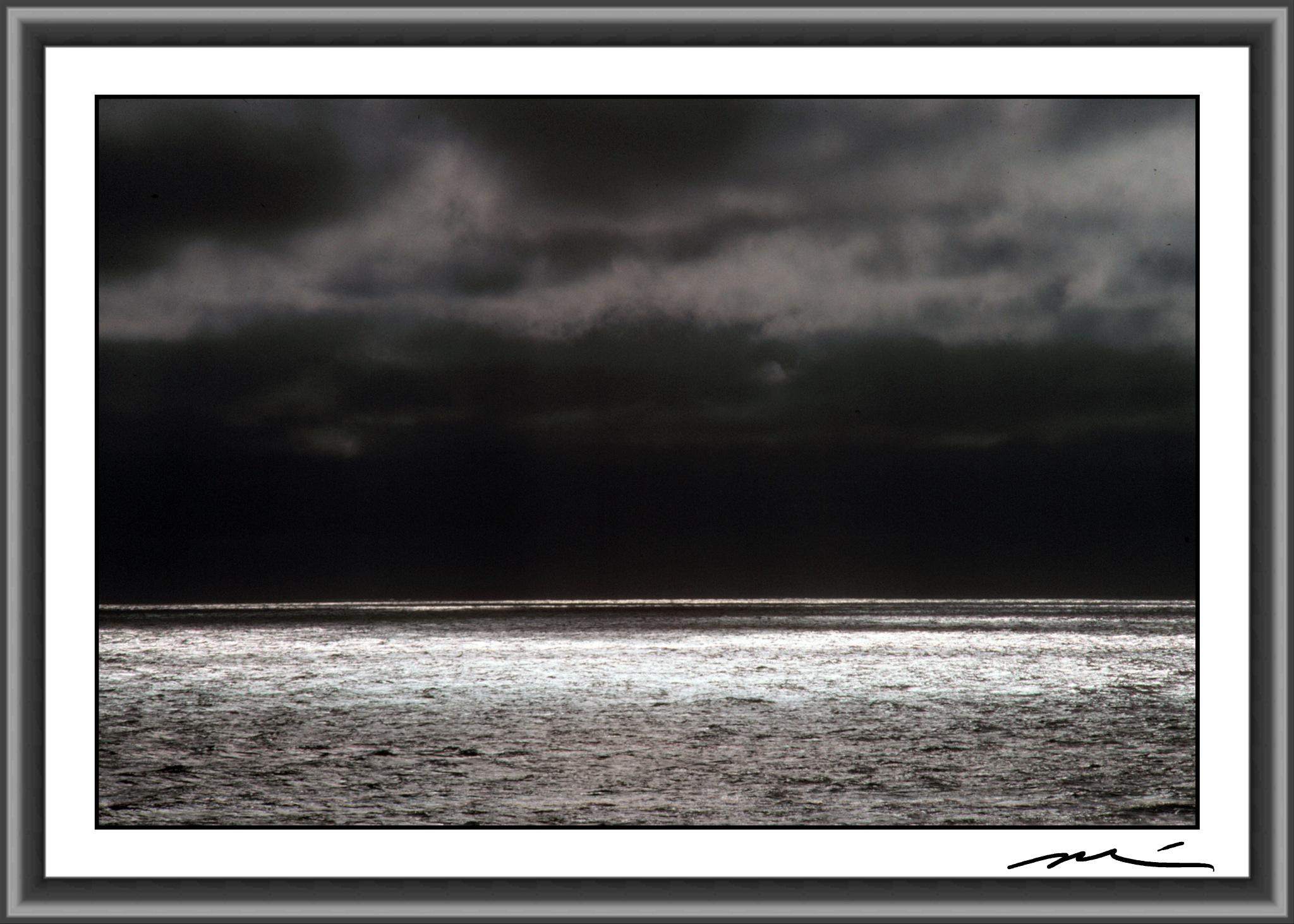 Darkening Skies Over A Shimmering Sea by Michael D. Davis